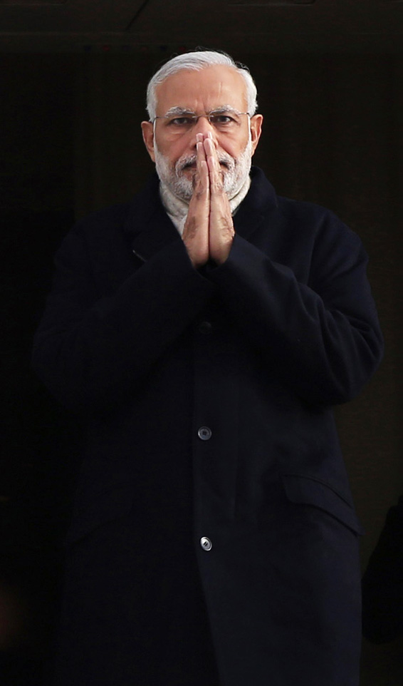 Indian Prime Minister Narendra Modi gestures as he arrives at Heathrow Airport, London, for an official three day visit  Thursday Nov. 12,  2015. (Jonathan Brady/PA Pool via AP)