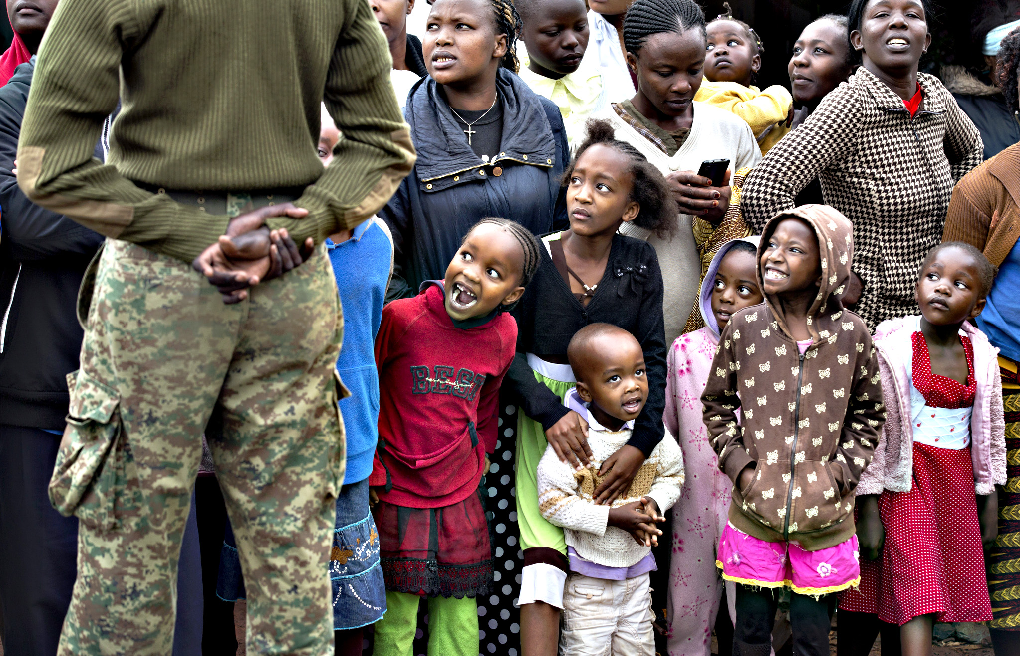 Children gasp as they watch a Kenyan Police helicopter fly overhead, while awaiting for the arrival of Pope Francis at the St. Joseph The Worker Catholic Church in the Kangemi slum of Nairobi, Kenya Friday, Nov. 27, 2015. Pope Francis is in Kenya on his first-ever trip to Africa, a six-day pilgrimage that will also take him to Uganda and the Central African Republic.