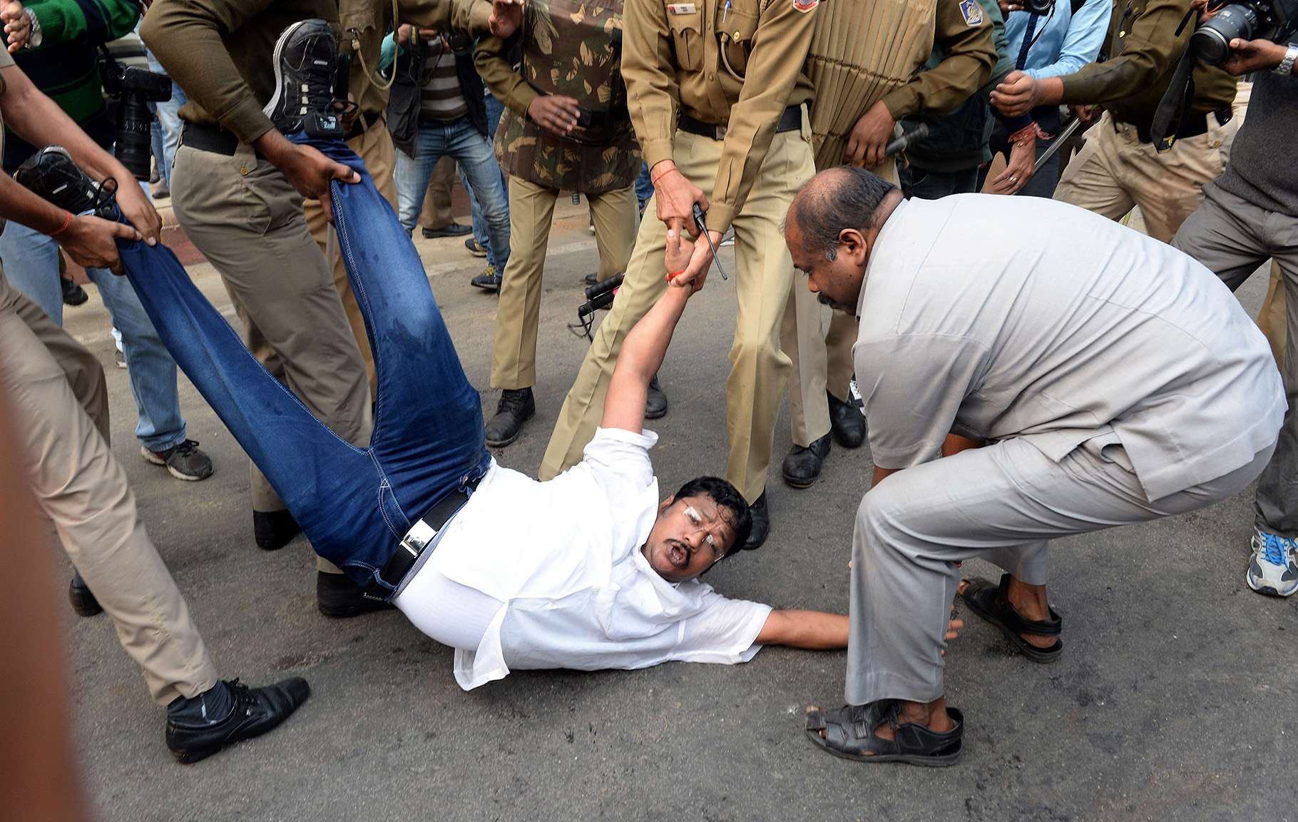 Indian security personnel detain activist