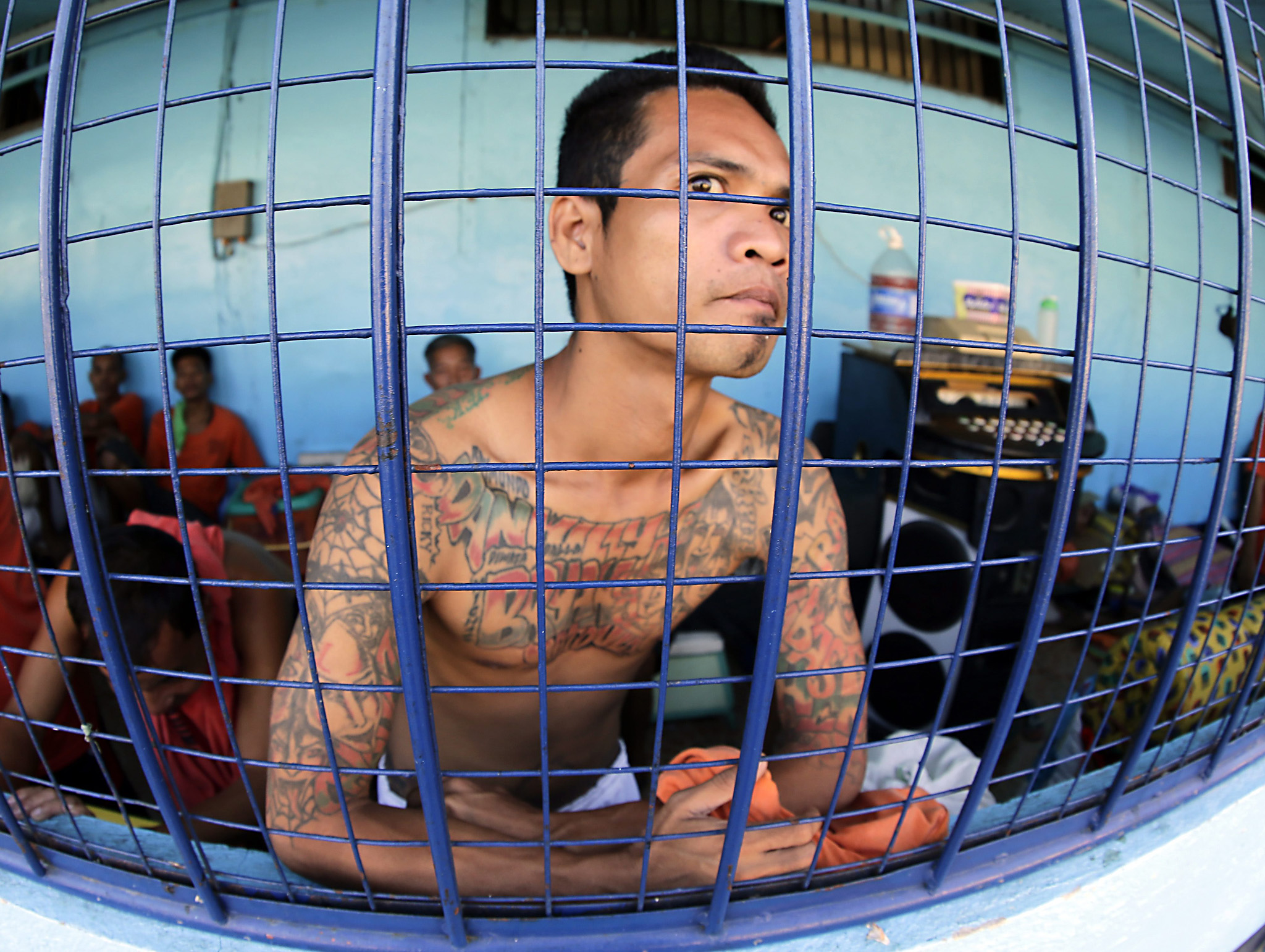 Prohibited items confiscated during raid at New Bilibid Prison in Muntinlupa...epaselect epa05009936 A Filipino inmate is seen inside a jail following a raid at the national prison in Muntinlupa city, south of Manila, Philippines, 04 November 2015. Joint forces from the Bureau of Corrections, Philippine Drug Enforcement Agency, and the National Bureau of Investigation found rifles, pistols, knives, bullets, refrigerators, televisions, drug paraphernalia, and equipment for making liquor, power tools, and cellphones from inmates at the maximum security compound of the National 'New Bilibid' Prison when they conducted a raid, according to a news report.  EPA/FRANCIS R. MALASIG