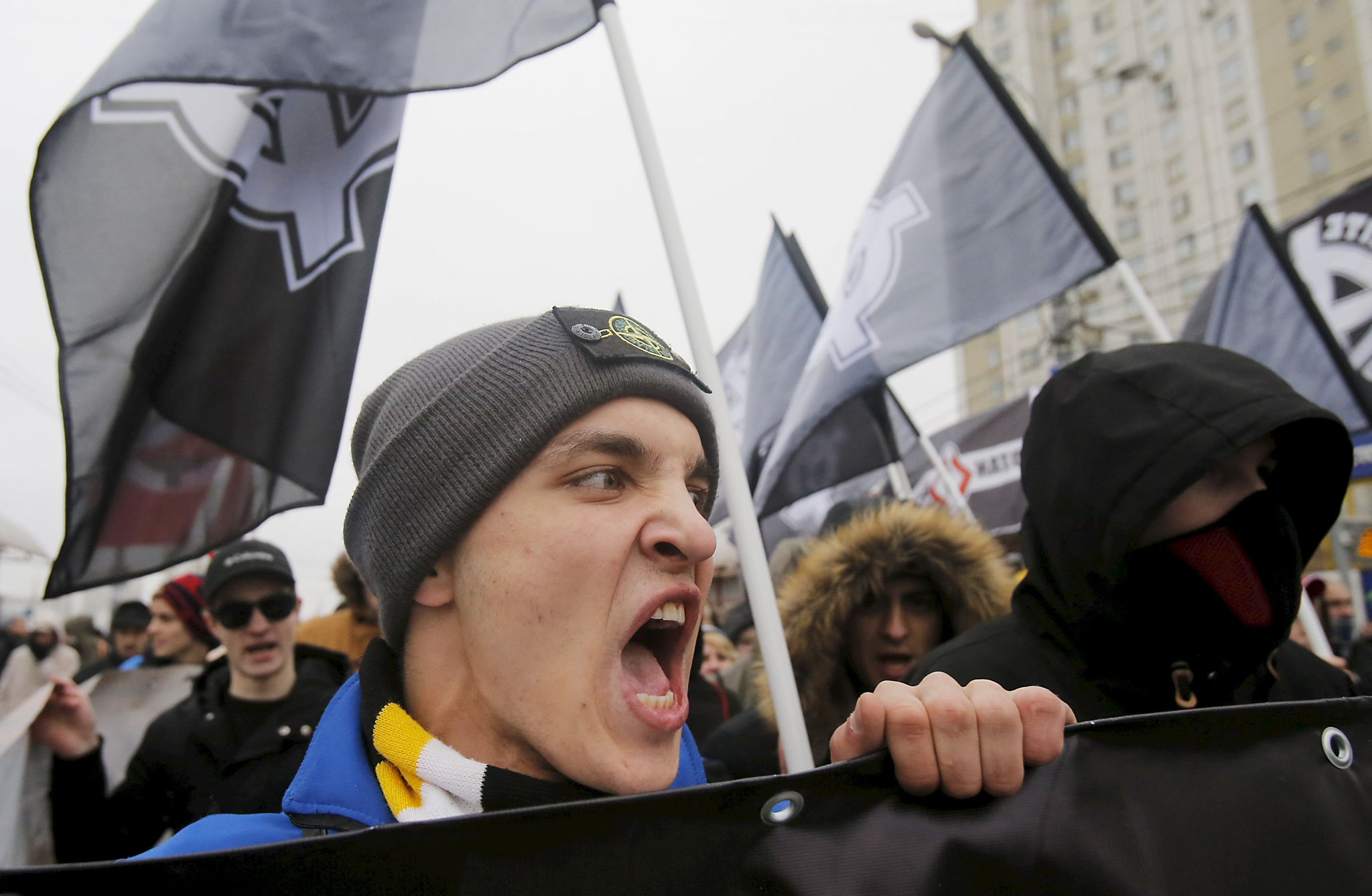 "Russian nationalists shout slogans during ""Russian March"" demonstration on National Unity Day in Moscow...Russian nationalists shout slogans during a ""Russian March"" demonstration on National Unity Day in Moscow, Russia November 4, 2015. Russia marks National Unity Day on November 4 to celebrate the defeat of Polish invaders in 1612. REUTERS/Maxim Shemetov"