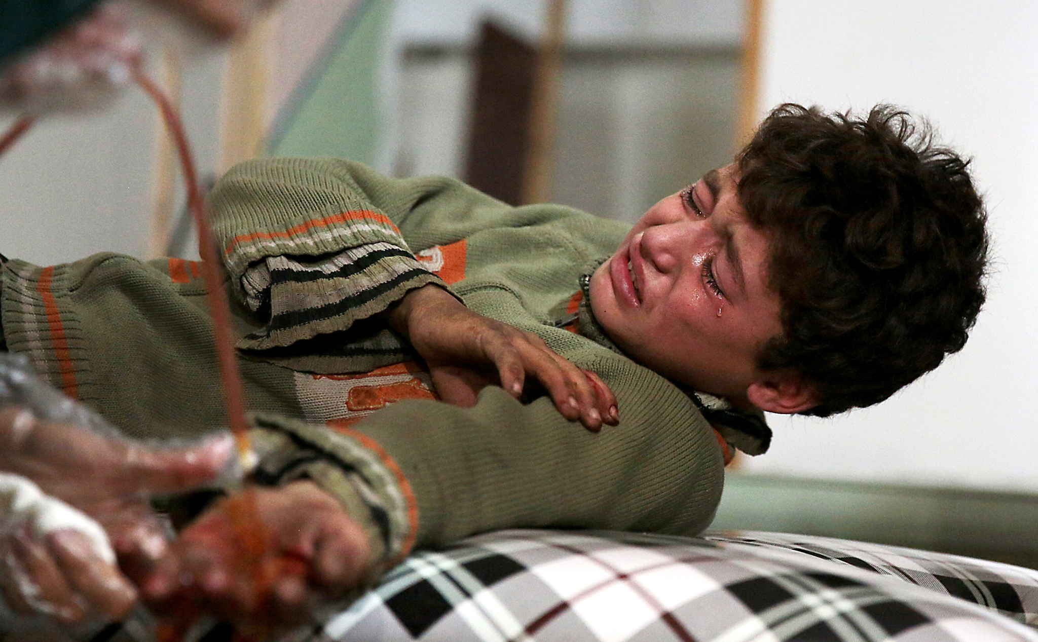 A wounded Syrian boy cries at a makeshif...A wounded Syrian boy cries at a makeshift hospital following a reported air strike by government forces in the rebel-held area of Douma, east of the capital Damascus, on November 18, 2015. AFP PHOTO / ABD DOUMANYABD DOUMANY/AFP/Getty Images