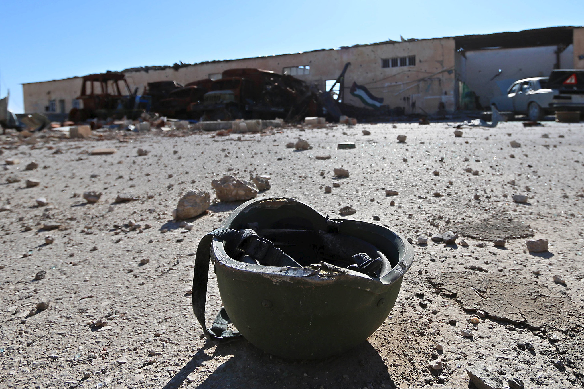 A helmet that belonged to Islamic State militants is seen on the ground at the 121 Regiment base after Fighters from the Democratic Forces of Syria took control of the base in the town of al-Melabiyyah, south of Hasaka city, Syria...A helmet belonging to a Islamic State militant is seen on the ground at the 121 Regiment base after Fighters from the Democratic Forces of Syria took control of the base in the town of al-Melabiyyah, south of Hasaka city, Syria November 24, 2015. Picture taken November 24, 2015. REUTERS/Rodi Said