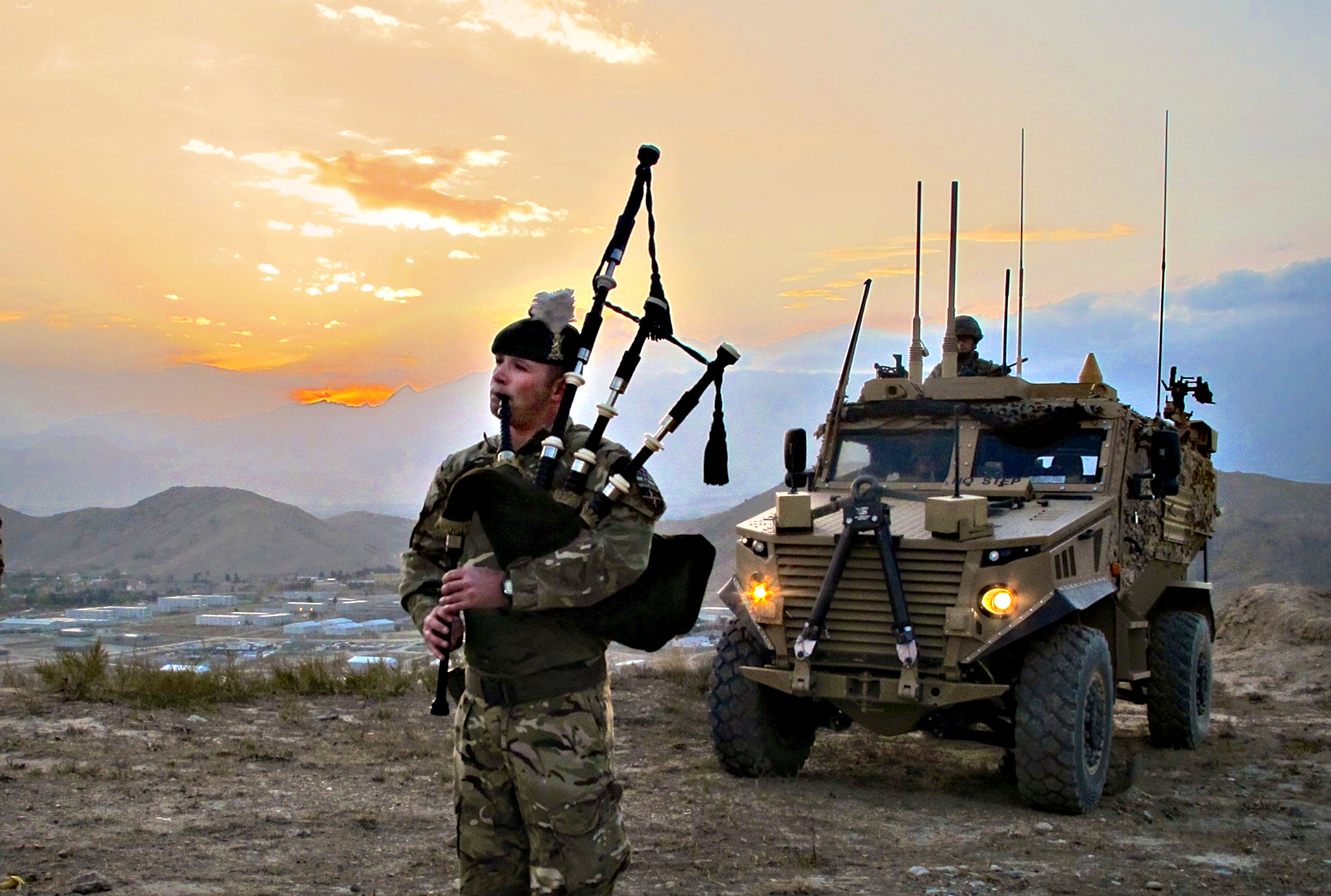 Corporal Kevin Glover (28) from Palnacki, Dumfries and Galloway, piping outside the battalion s base at Camp Qargha to celebrate St Andrew s Day