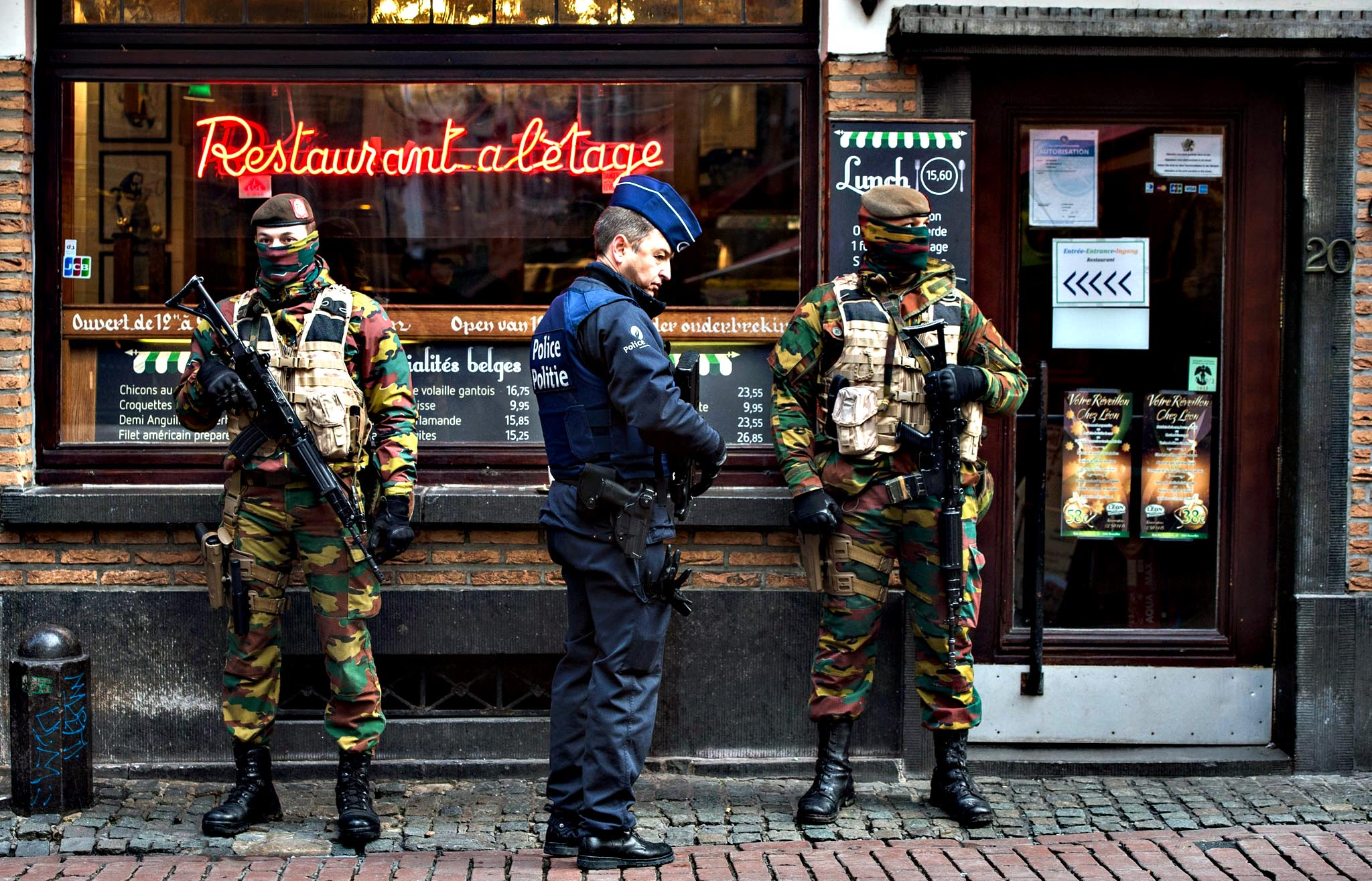 A Police officer and soldiers stand guard  in the 'Rue des Bouchers' street, famous for it's restaurants, following the terror alert level being elevated to 4/4, in Brussels, Belgium. Belgium raised the alert status at Level 4/4 as 'serious and imminent' threat of an attack, the main effect are closing of all Metro Line in Brussels, all soccer match of league one and two cancelled countrywide. The Belgian government said it had concrete evidence of a planned terrorist attack that would have employed weapons and explosives