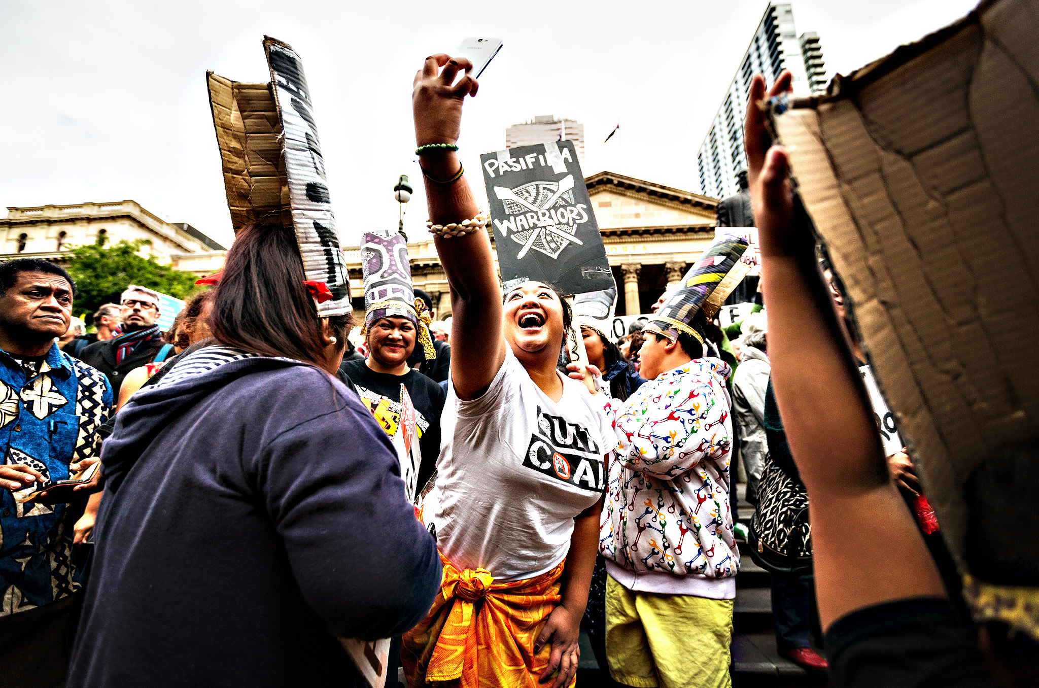 Thousands gather at the steps of the State Library before marching on Friday in Melbourne, Australia. The march is part of a national movement ahead of the United Nations climate summit in Paris on Monday