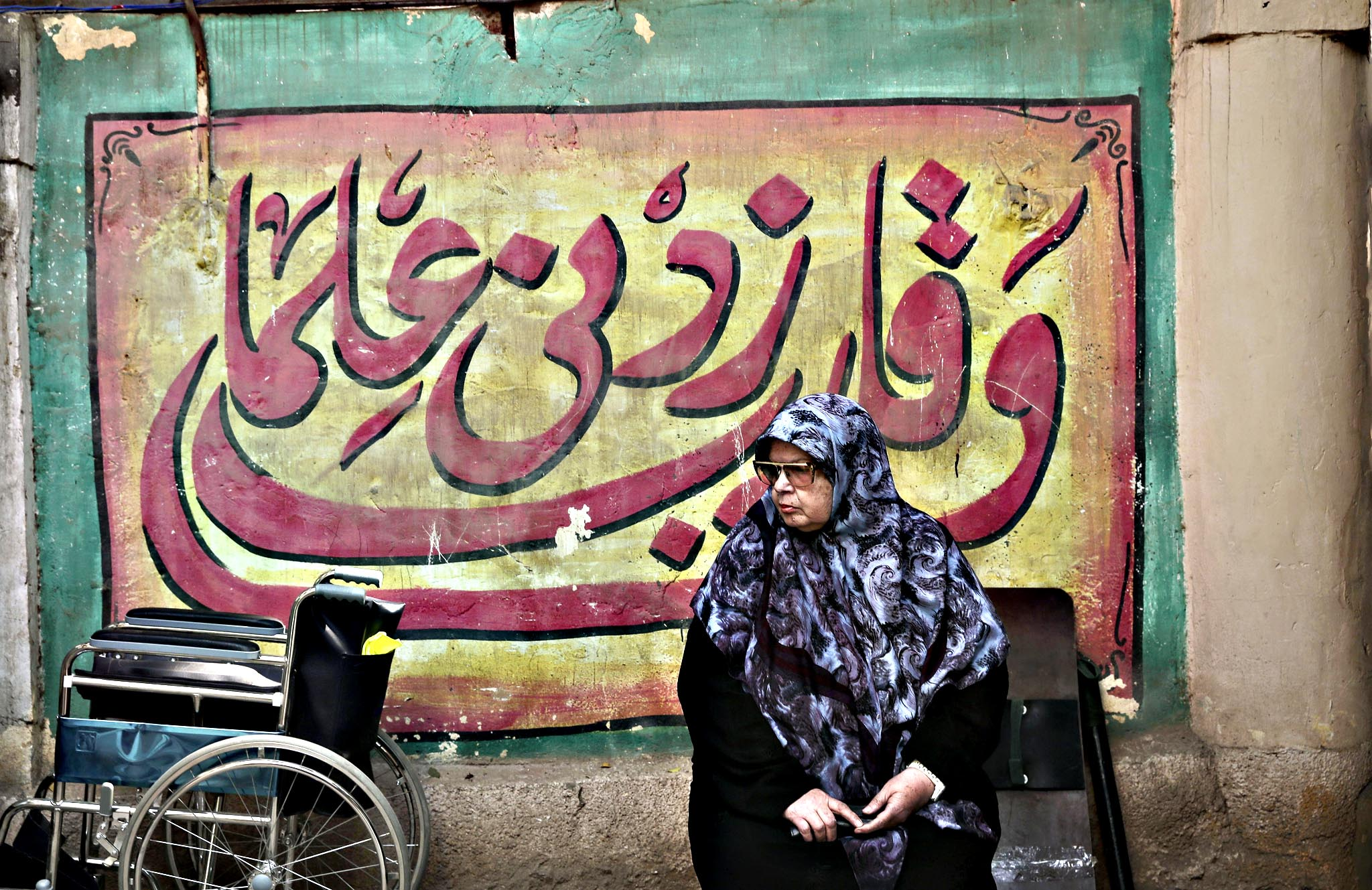 An Egyptian woman waits for an election worker to check her identification card inside a polling center during the second phase of the parliamentary election, in the Maadi district of Cairo, Egypt, Monday, Nov. 23, 2015.