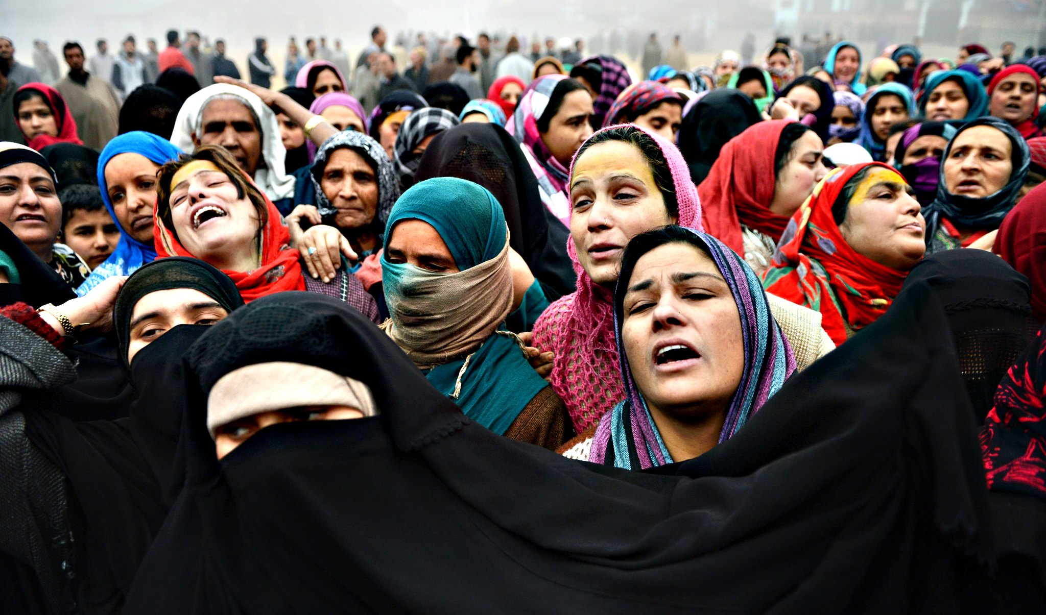 Kashmiri villagers mourn at a funeral procession for suspected rebels in the village of Bijbehara, in Anantnag district south of Srinagar, on Tuesday. Three suspected rebels were killed on Sunday, during an encounter with security forces in southern Kashmir
