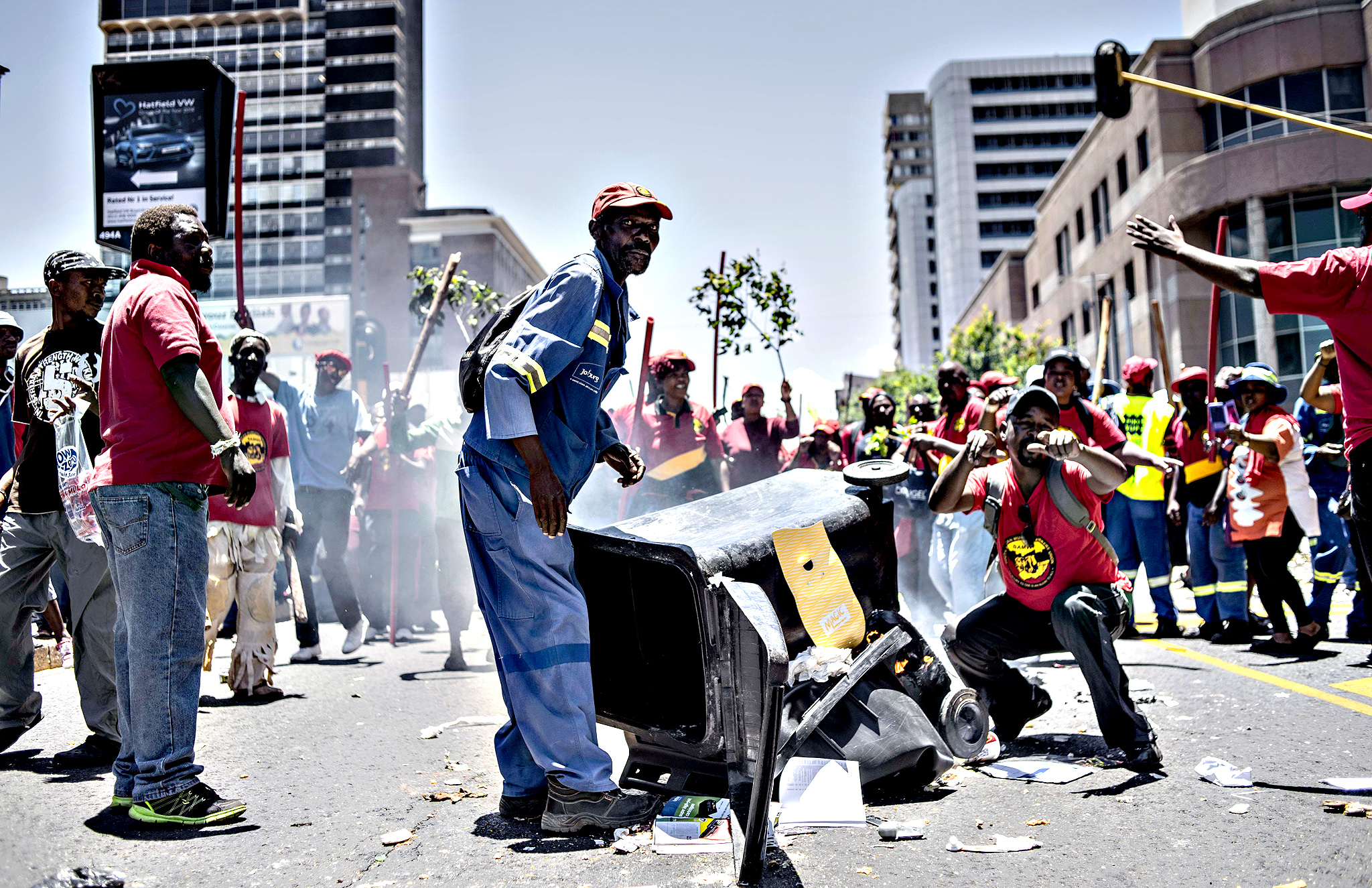 Members of the South African Municipal Workers' Union (SAMWU) protest in front of the Nelson Mandela Bridge in Braamfontein, Johannesburg, on November 24, 2015. SAMWU members marched to demand increased wages, better working conditions and new recruitments to reduce municipal water management vacancy rate in water-stressed municipalities in light of the current drought in South Africa.