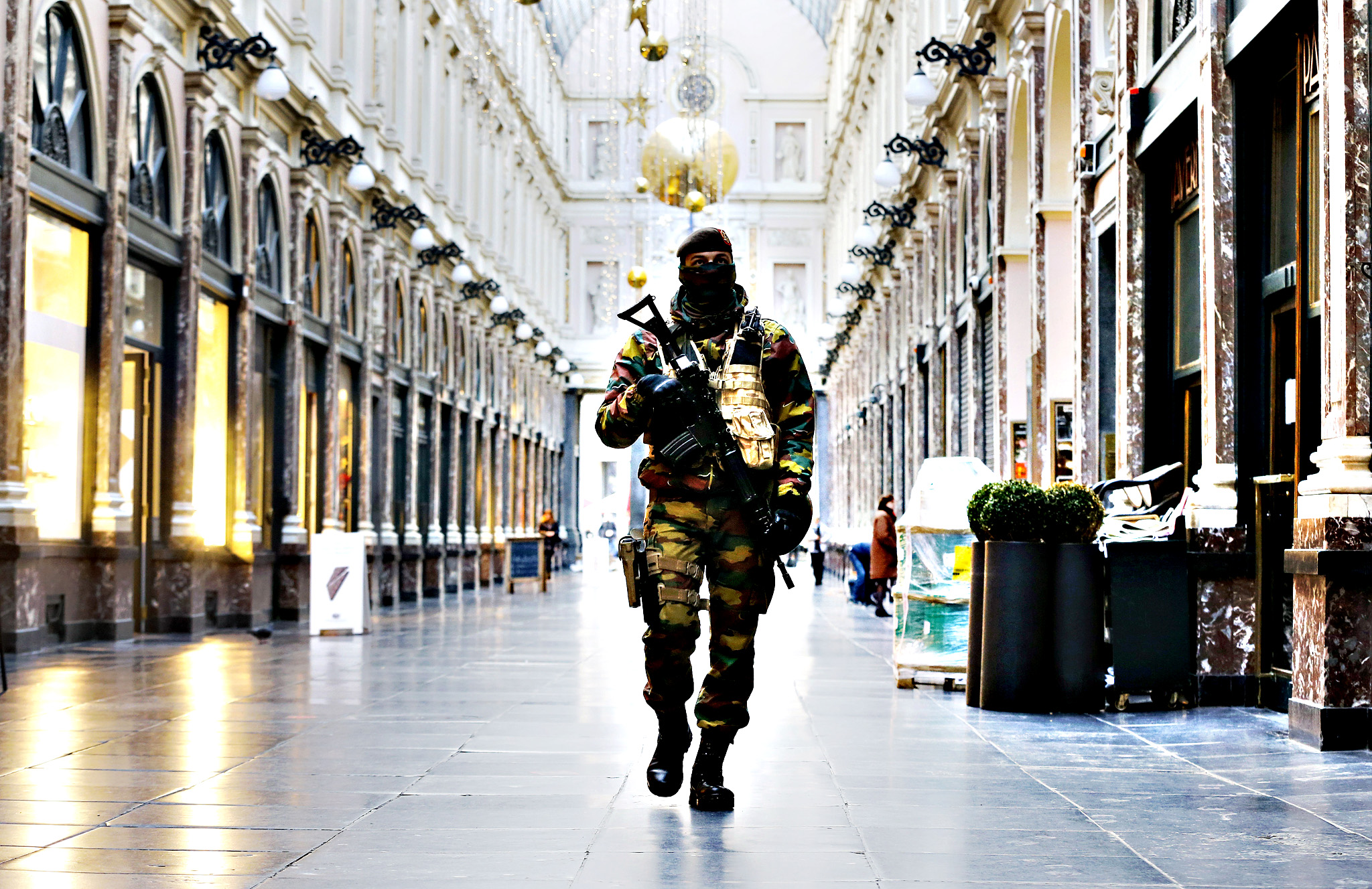 A Belgium army soldier walks through the Galeries Royal Saint-Hubert, or the Royal Saint-Hubert Galleries in Brussels, Belgium, Thursday, Nov. 26, 2015. Brussels is keeping its terror alert on highest level.