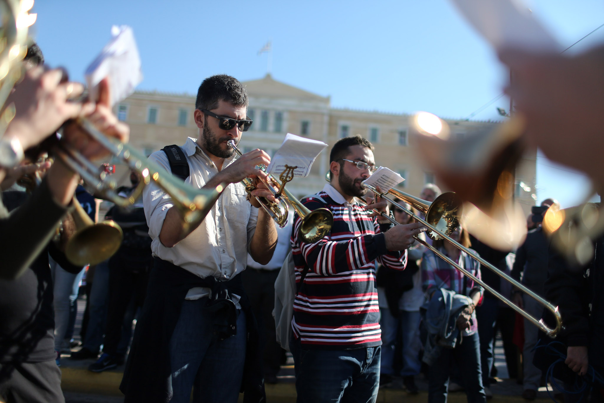rotesting members of the PAME Communist-affiliated union play music outside the Greek parliament