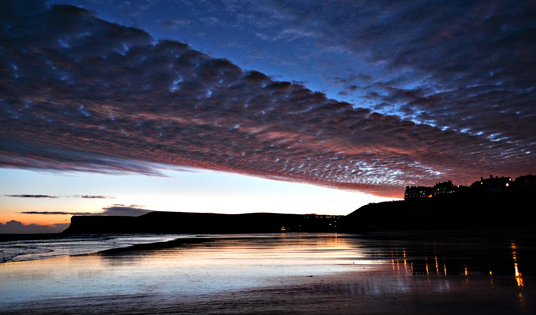 Clouds are lit by the first light of dawn during a winter sunrise on November 25, 2015 in Saltburn-by-the-Sea, England. After a mild week the wintery weather is due to return over the weekend.