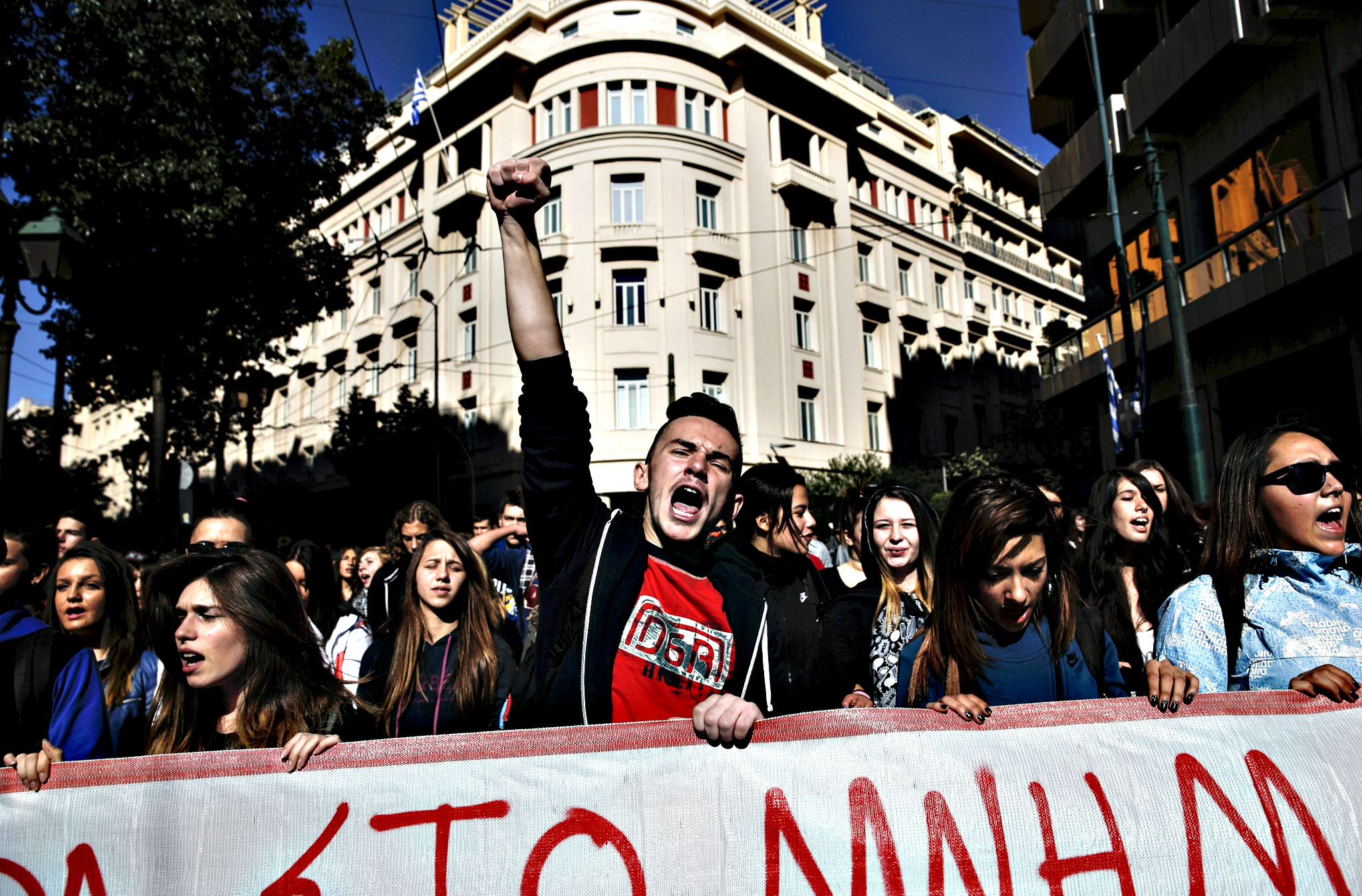 Students shout slogans during a demonstration of thousands of students against government reforms in education in central Athens, Greece, on Monday