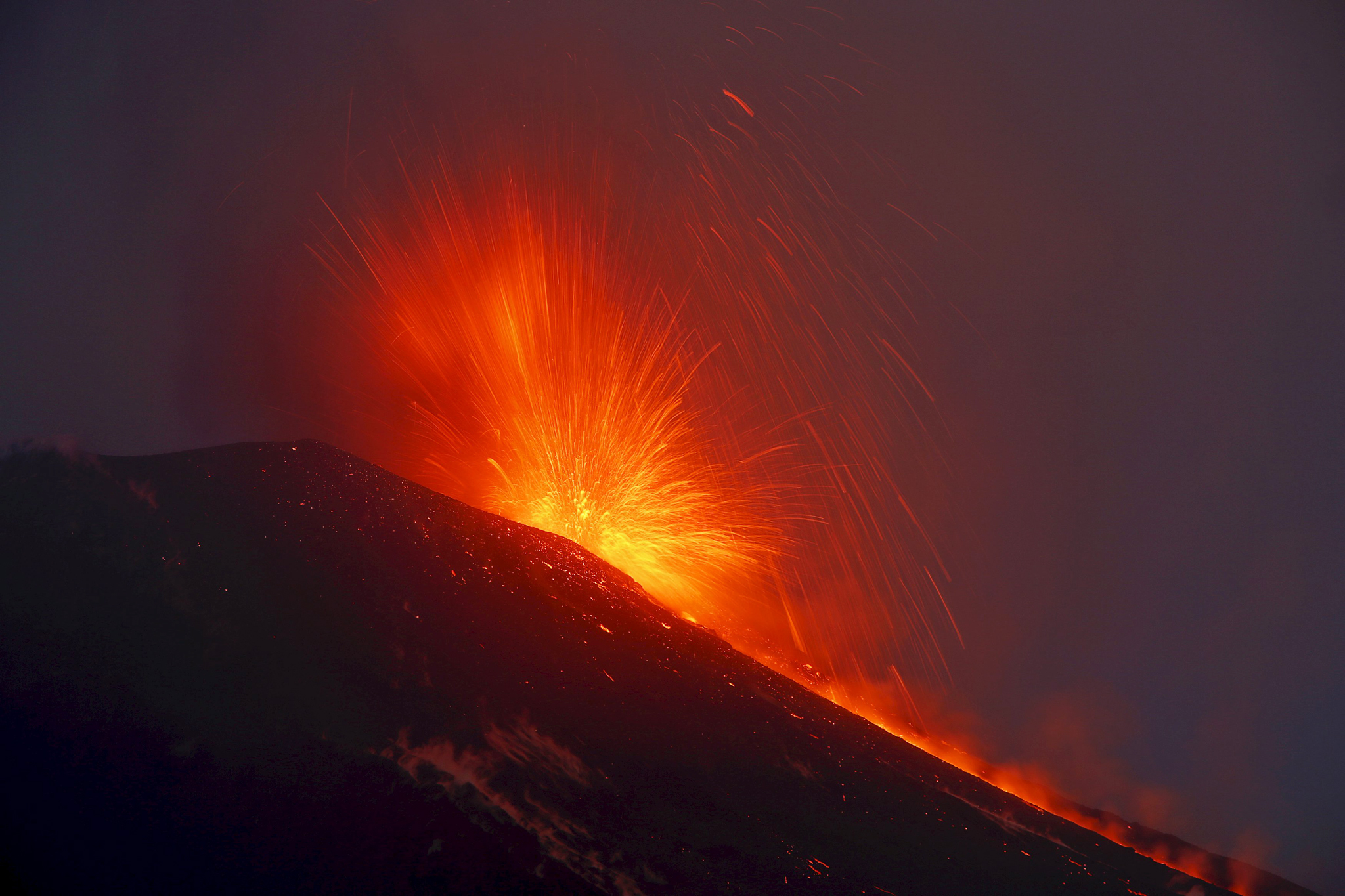 Italy's Mount Etna, Europe's tallest and most active volcano, spews lava as it erupts on the southern island of Sicily...Italy's Mount Etna, Europe's tallest and most active volcano, spews lava as it erupts on the southern island of Sicily, Italy December 7, 2015. REUTERS/Antonio Parrinello      TPX IMAGES OF THE DAY
