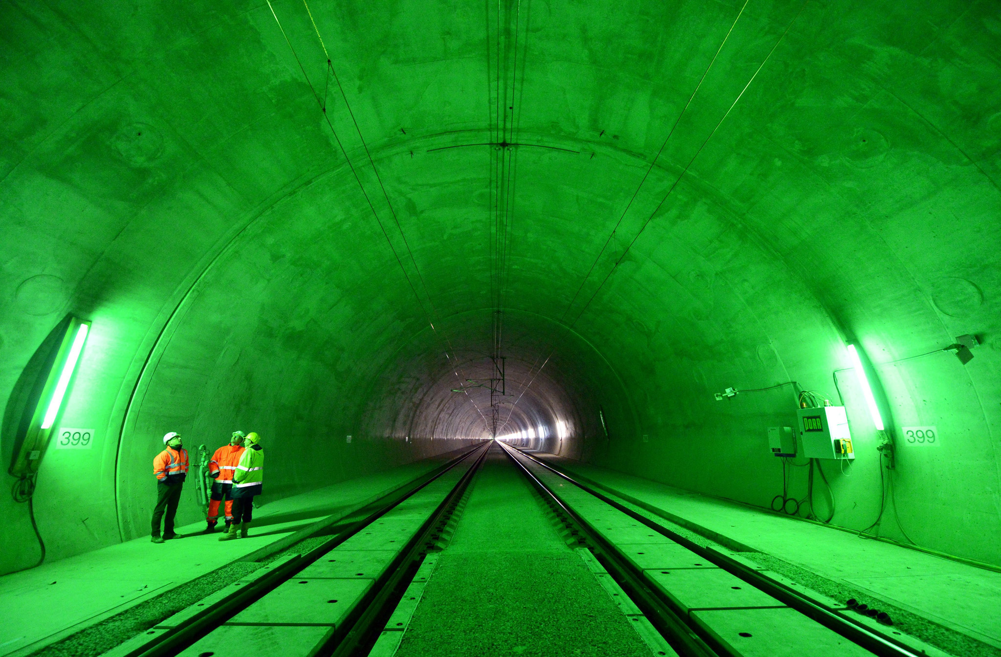 Silberberg Tunnel on the new ICE route...epa05058295 Construction workers stand next to the tracks for the future German high-speed ICE train route inside the 'Silberberg Tunnel' near Grossbreitenbach, Germany, 07 December 2015. The Silberberg Tunnel is 7,391 meters long and the second longest tunnel on the new route between Ebensfeld and Erfurt.  EPA/MARTIN†SCHUTT