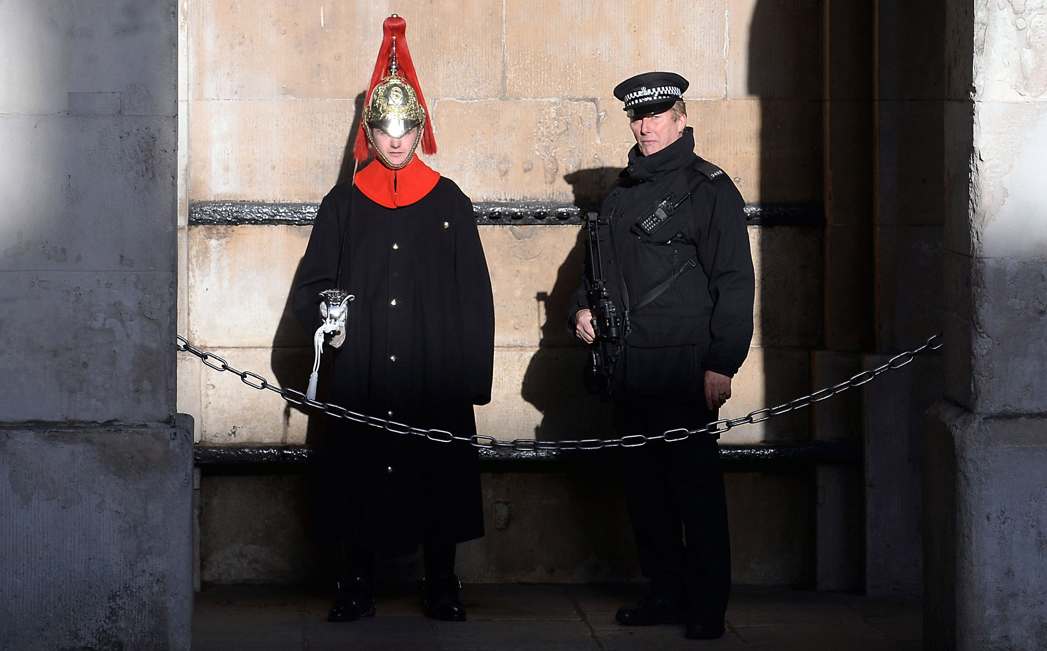 Armed police officers in Westminster, London, as thousands of police including increased numbers of firearms officers will be on duty as the capital ushers in the New Year tonight. PRESS ASSOCIATION Photo. Picture date: Thursday December 31, 2015. Scotland Yard said there will be around 3,000 officers across central London as mayor Boris Johnson's fireworks display with Unicef brings in 2016. See PA story SOCIAL Year. Photo credit should read: Stefan Rousseau/PA Wire