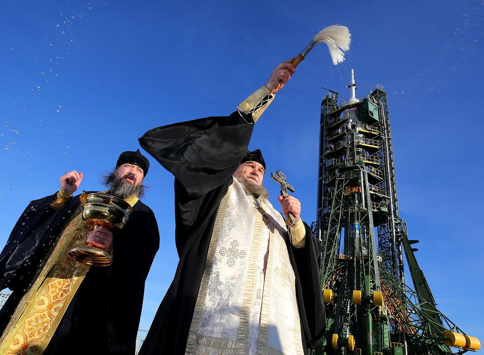 A Russian Orthodox priest blesses the media and well-wishers