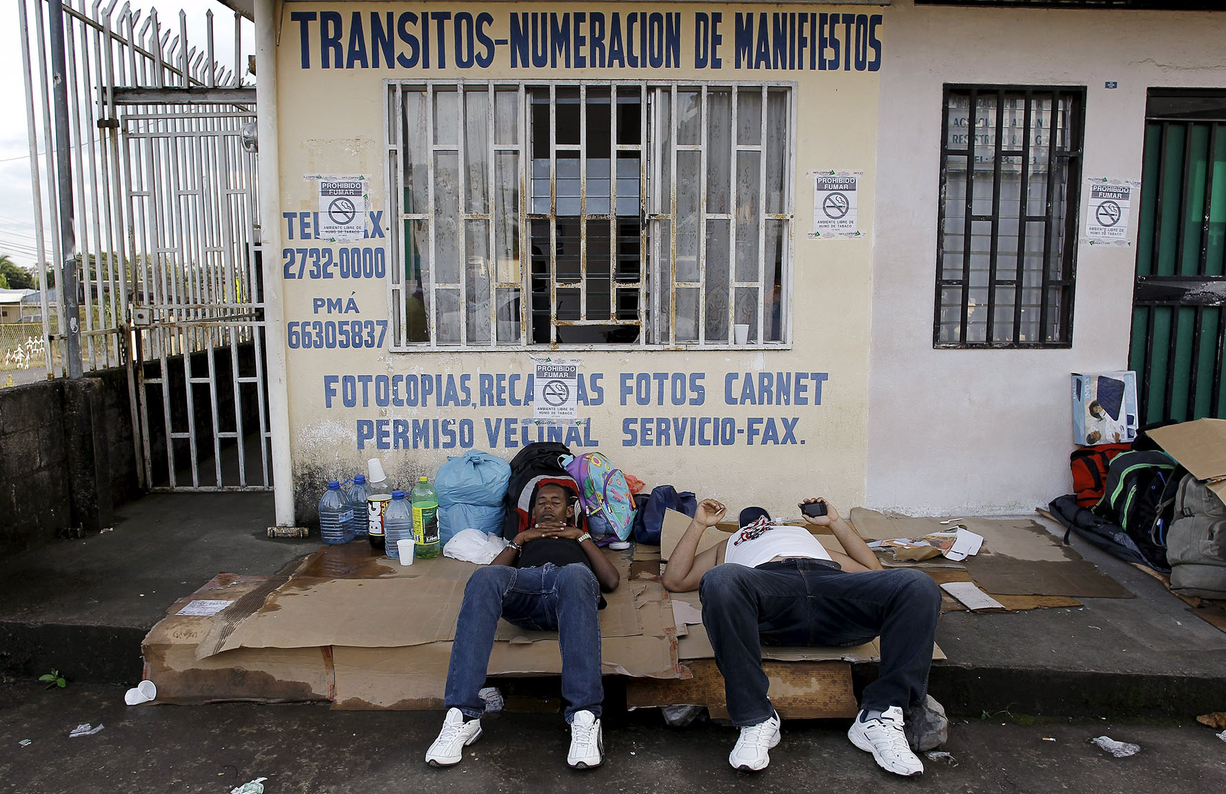 Cuban migrants rest at a border post with Panama in Paso Canoas