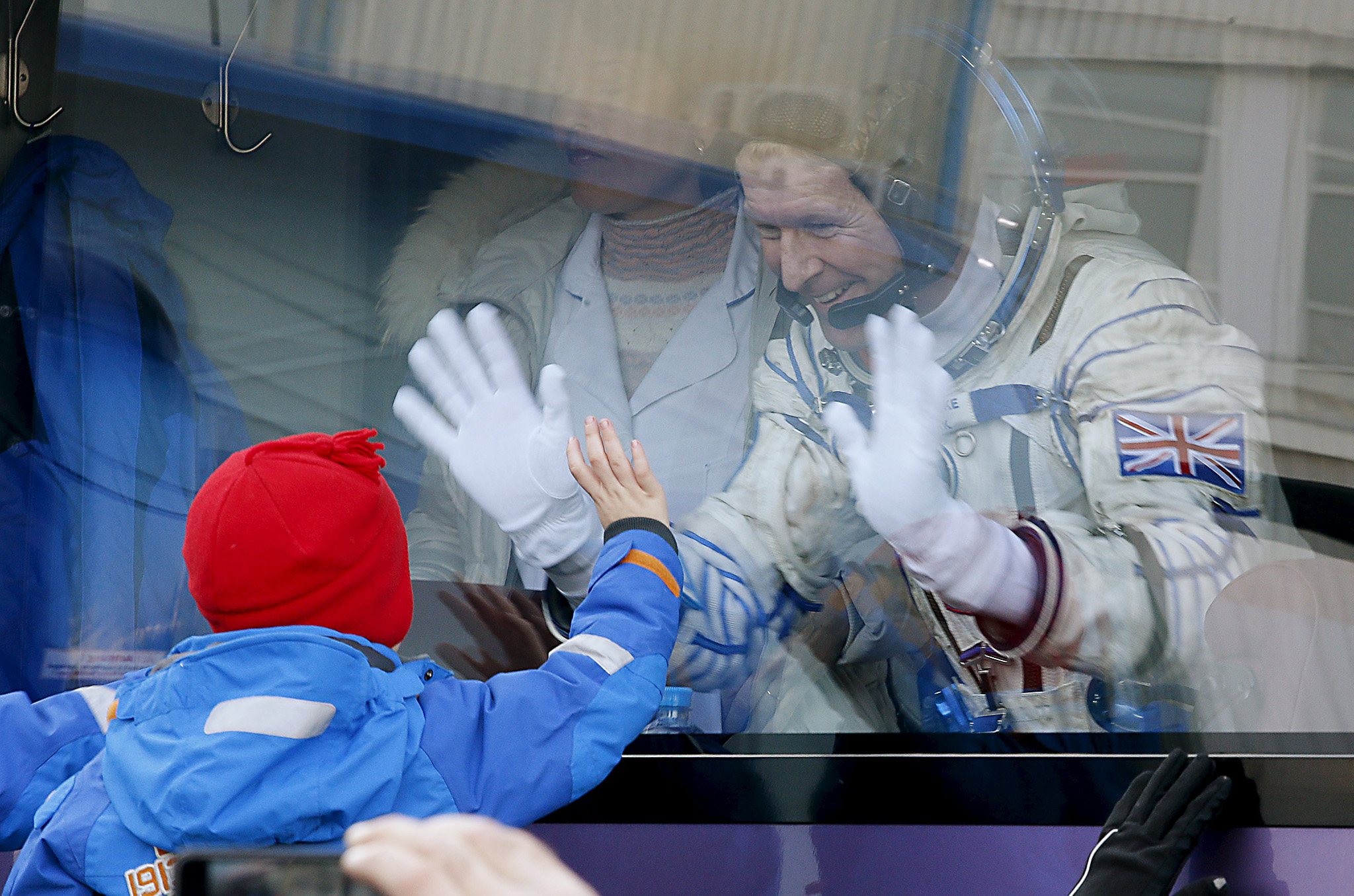 British astronaut Tim Peake, member of the main crew of the expedition to the International Space Station (ISS), waves to his children from a bus prior the launch of Soyuz TMA-19M space ship at the Russian leased Baikonur cosmodrome, Kazakhstan...British astronaut Tim Peake, member of the main crew of the expedition to the International Space Station (ISS), waves to his children from a bus prior the launch of Soyuz TMA-19M space ship at the Russian leased Baikonur cosmodrome, Kazakhstan, Tuesday, Dec. 15, 2015.  REUTERS/Dmitry Lovetsky/Pool