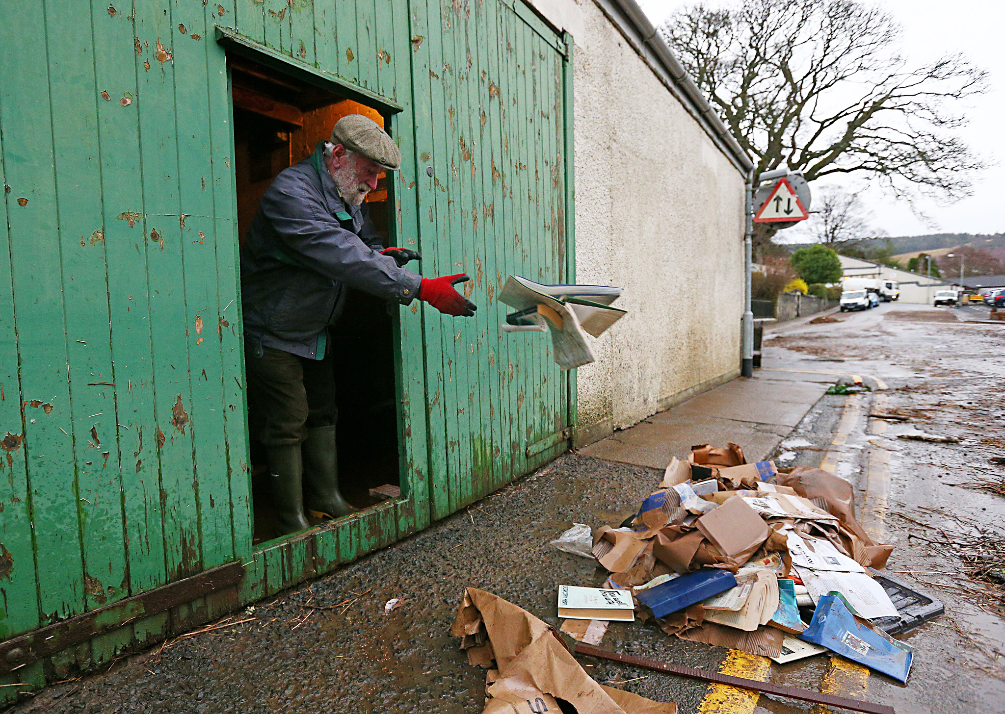 A local man clears out his lock up that was inundated by flood water after the river Tweed burst it's banks flooding the area on December 31, 2015 in Peebles, Scotland. Storm Frank is the latest winter storm to bring heavy rain fall and flooding to the north of England and Scotland, causing widespread disruption to transport and infrastructure.