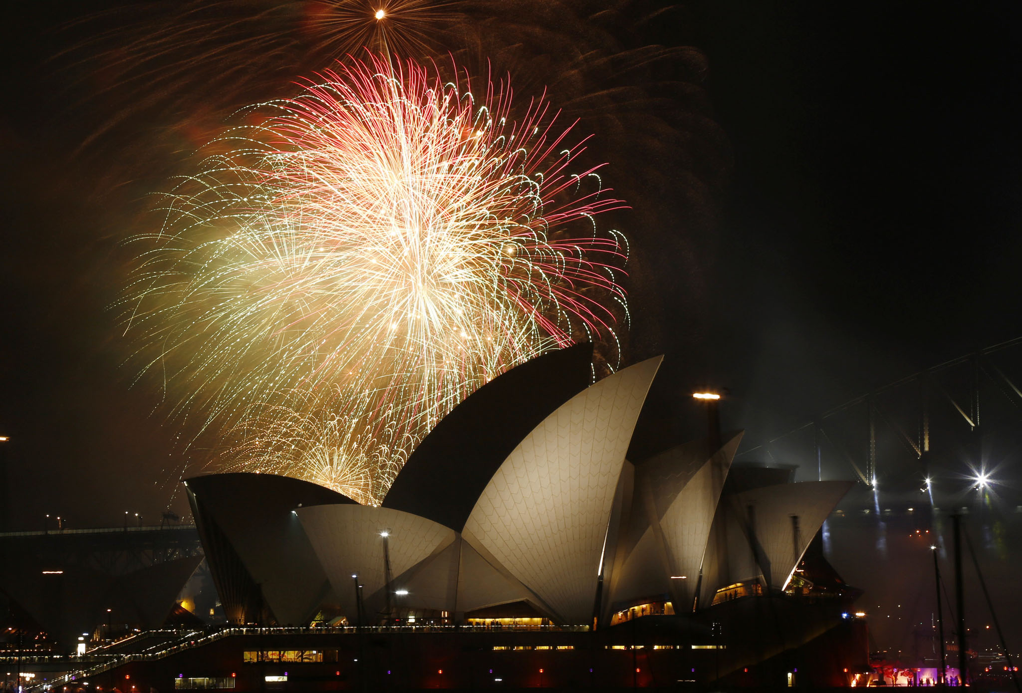 Fireworks explode over the Sydney Opera House in a 9pm display before the midnight fireworks which will usher in the new year in Australia's largest city...Fireworks explode over the Sydney Opera House in a 9pm display before the midnight fireworks which will usher in the new year in Australia's largest city, December 31, 2015. REUTERS/Jason Reed