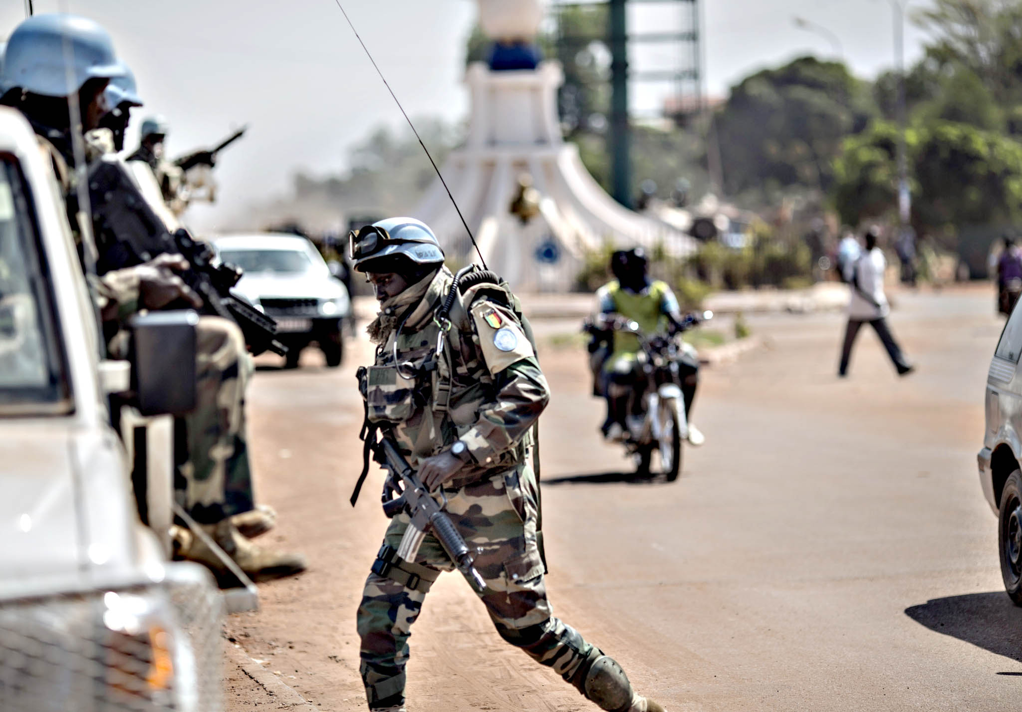 "Senegalese soldiers from MINUSCA (United Nations Mission in Central African Republic) patrol in the area where sporadic gunfire and improvised barricades closed the access to some district of Bangui on December 10, 2015.  Gunfire erupted on December 8, 2015 in the Central African Republic's capital Bangui, where protesters erected barricades after an announcement that ex-president Francois Bozize was barred from running for election. A French embassy text message sent to citizens said there were ""barricades and gunfire"" in several districts and advised French citizens ""to avoid these areas""."