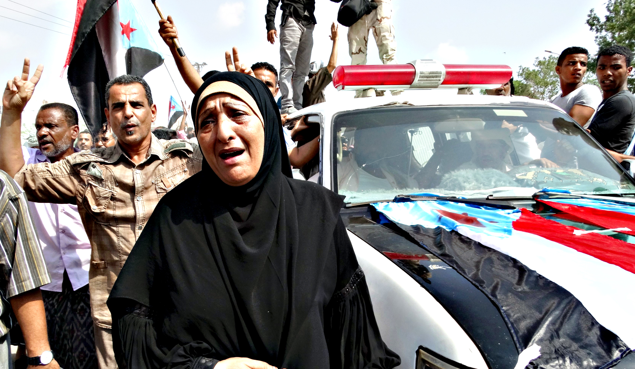 A woman reacts as she attends the funeral of the governor of Yemen's southern port city of Aden on Tuesday. The governor of Yemen's Aden province Jaafar Mohammed Saad was killed on Sunday when a suicide bomber rammed his car into the governor's convoy in the western part of Aden city