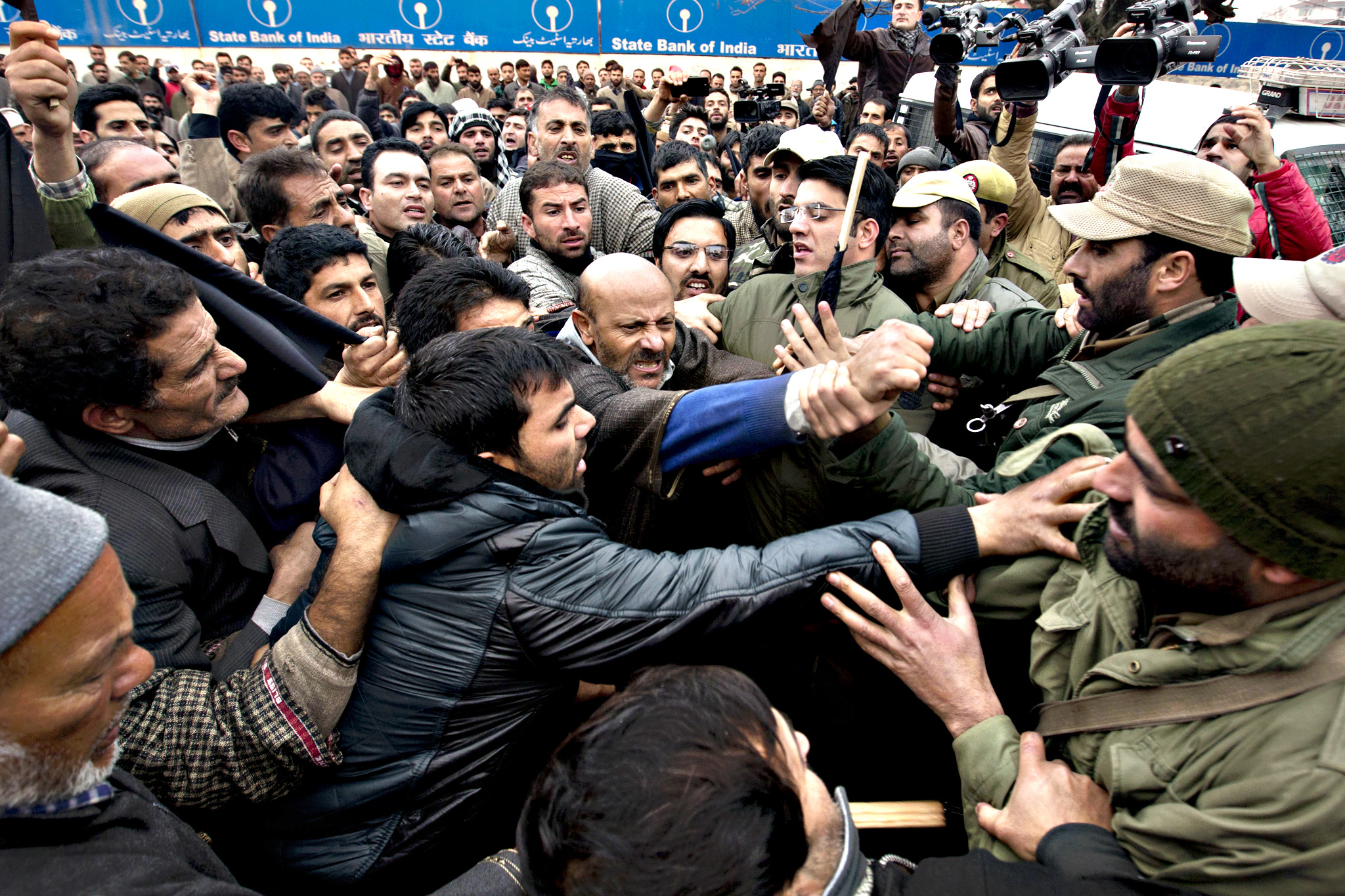 Activists of the Awami Ittihad party get into a scuffle with Indian policemen as they are stopped during a protest to mark International Human Rights Day in Srinagar, India, Thursday, Dec. 10, 2015.