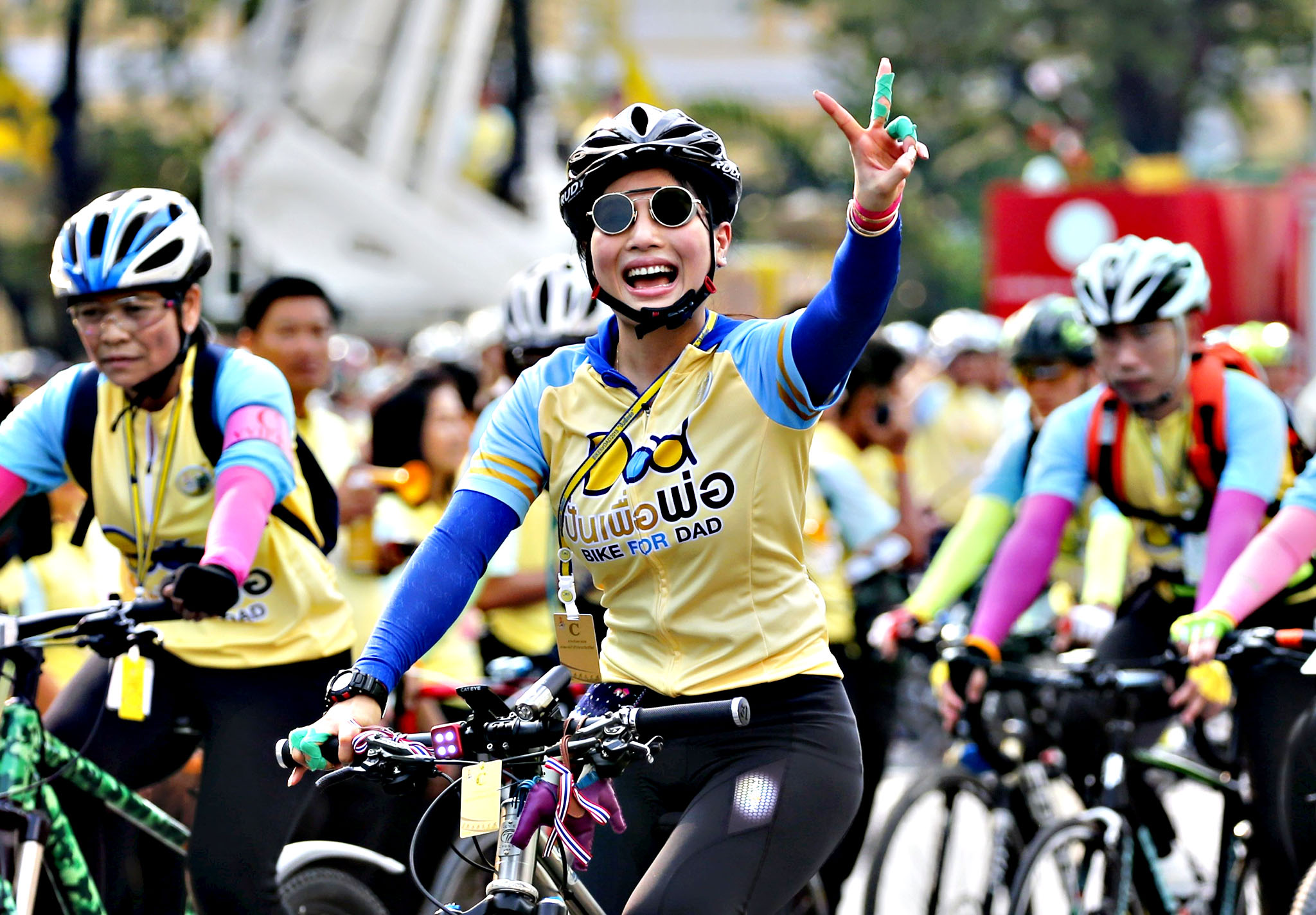 "Thailand's Princess Sirivannavari Nariratana waves to crowd as she cycles in the ""Bike for Dad"" event in Bangkok, Thailand, December 11, 2015. Thai Crown Prince Maha Vajiralongkorn led thousand of cyclists on a 29-km course in Bangkok to celebrate King Bhumibol Adulyadej's 88th birthday which fell on December 5."