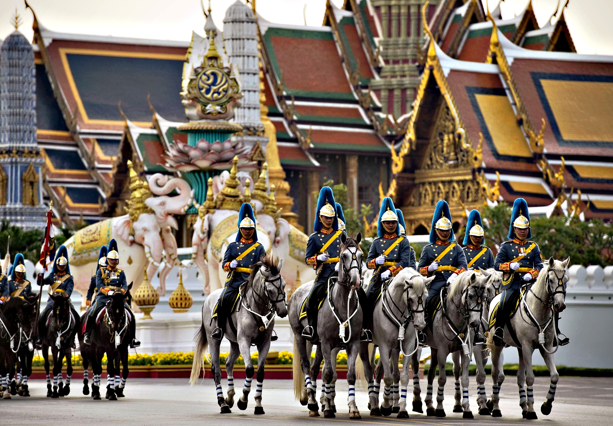 Royal cavalry soldiers parade in front of the Grand Palace as part of celebrations of the 88th birthday of Thai King Bhumibol Adulyadej in Bangkok on Thursday. Thai King Bhumibol, the world's longest reigning monarch who is regarded as a demi-god by many Thais and considered a unifying force in a politically turbulent nation, will turn 88 on December 5, 2015.