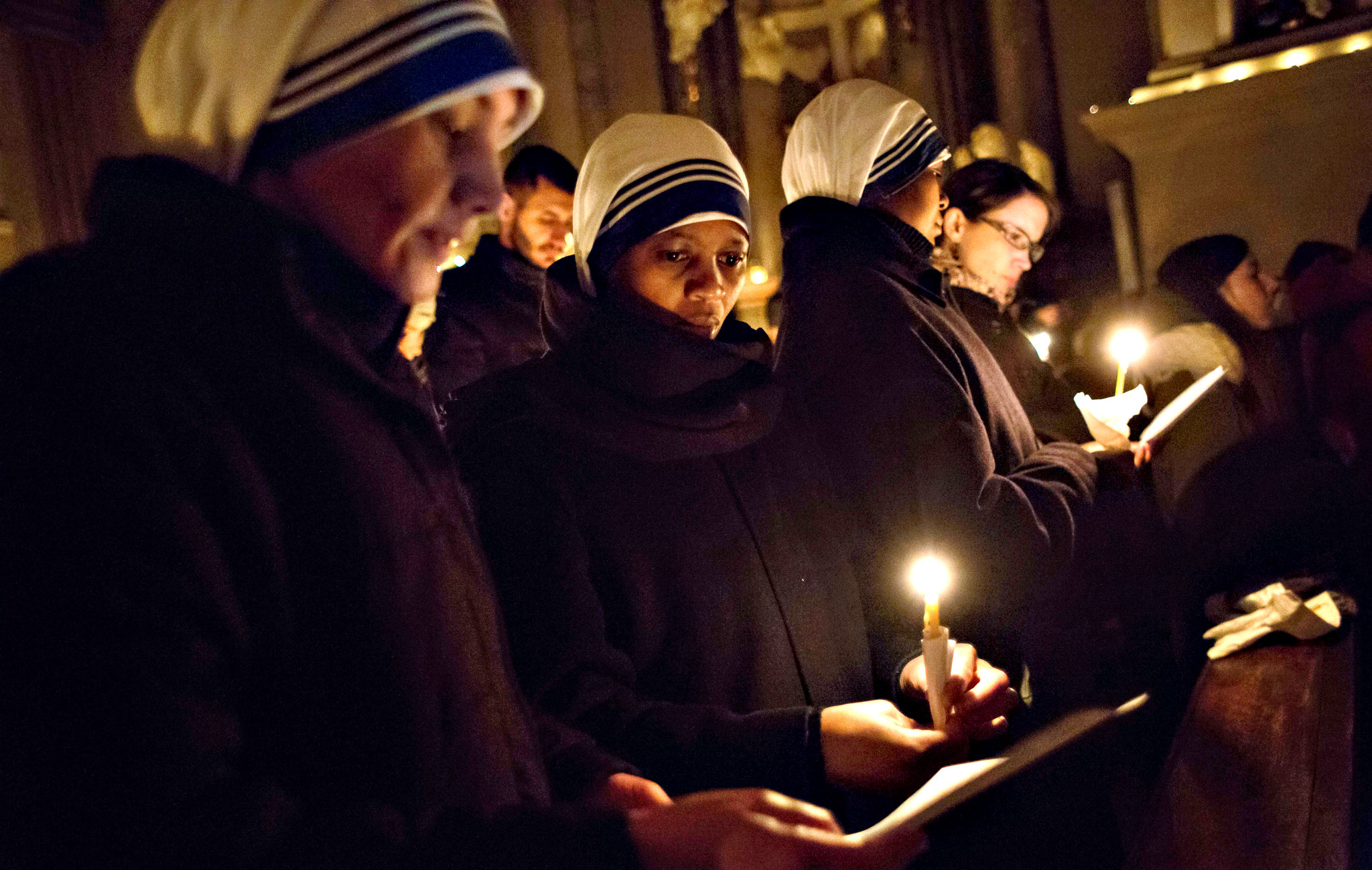 Nuns pray during an early morning Rorate mass in Frnaciscan church in Bratislava on December 17, 2015.   Rorate Mass which is traditionally celebrated in Advent, in honour of Holy Mary, in the dark of the morning before sunrise, by candlelight.