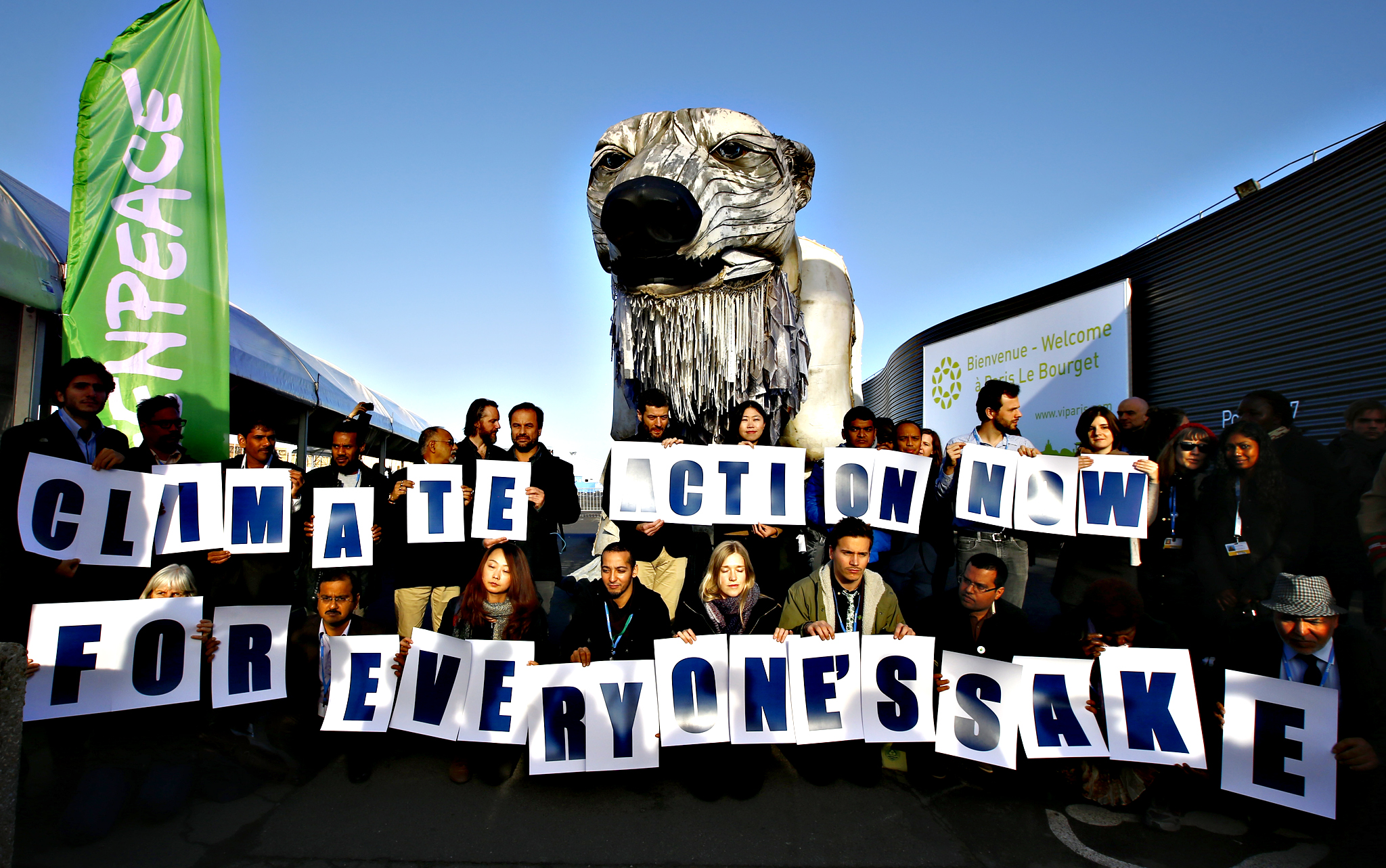 Activists from Greenpeace stage a protest in front of a two-story-high, mechanically operated polar bear called Aurora into the conference venue, to represent everyone hoping in the next 72 hours during the COP21, United Nations Climate Change Conference in Le Bourget, north of Paris, France,  Wednesday, Dec. 9, 2015.