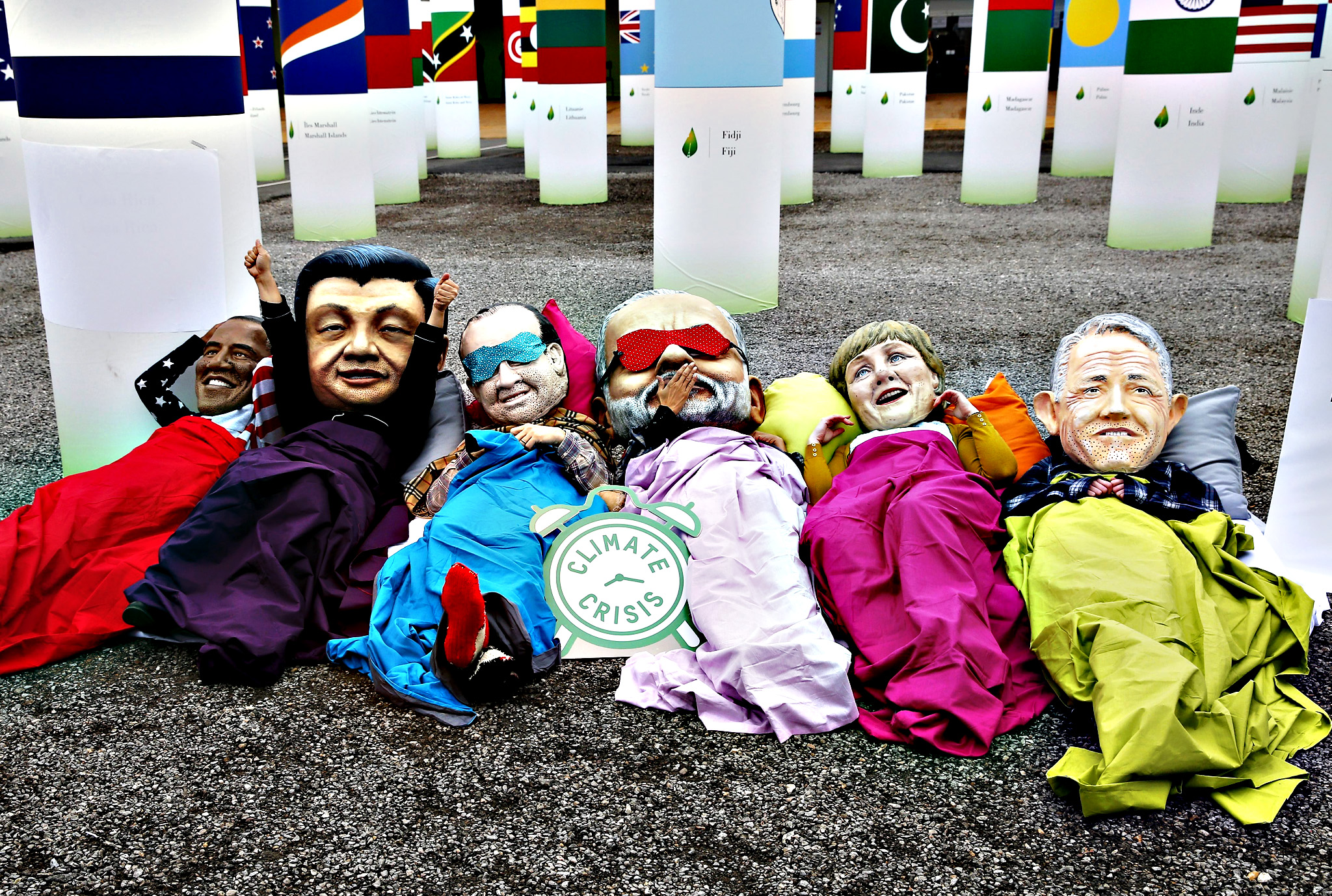 Demonstrators from NGO Oxfam wear big heads of world leaders, US President Barack Obama, Chinese President Xi Jinping, French President Francois Hollande, Indian Prime Minister Narendra Modi, German Chancellor Angela Merkel and Australian Prime Minister Malcolm Turnbull, in front of the COP21 conference center in Le Bourget, north of Paris, France, 10 December 2015. The 21st Conference of the Parties (COP21) is held in Paris from 30 November to 11 December aimed at reaching an international agreement to limit greenhouse gas emissions and curtail climate change