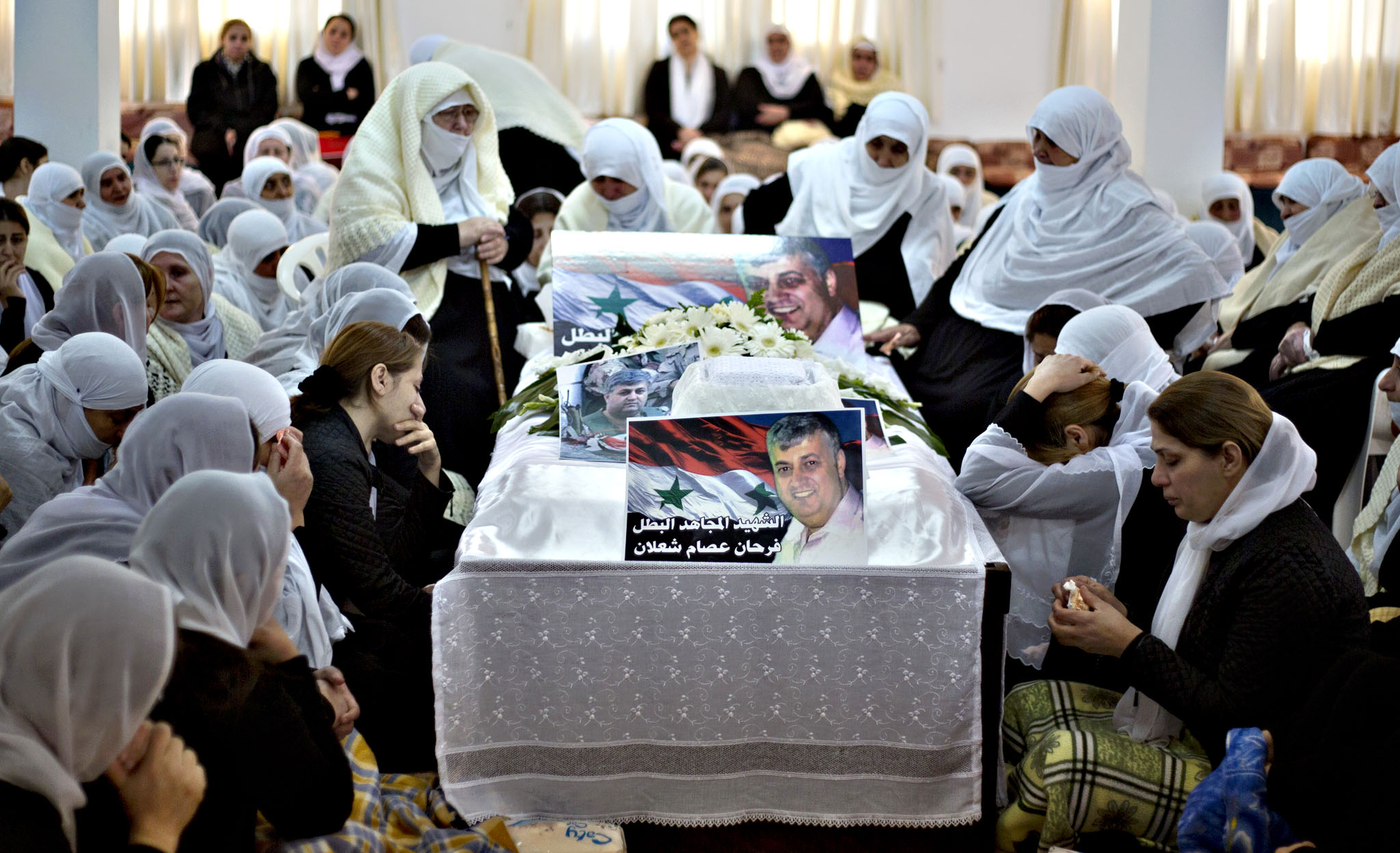 Druze women mourn their relatives Farhan al-Shaalan and Samir Kantar, who were killed from an Israeli airstrike near the Syrian capital, in the Druze village of Ein Kinya in the Israeli controlled Golan Heights, near the border with Syria. Kantar, a Lebanese who was convicted of carrying out one of the most notorious attacks in Israeli history and spent nearly three decades in an Israeli prison, has been killed by an Israeli airstrike near the Syrian capital, the Lebanese Shiite Hezbollah group said Sunday. Al-Mayadeen said that al-Shaalan, a senior commander with the anti-Israeli  resistance  movement in the Golan Heights, was also killed in the air raid together with an aide to Kantar