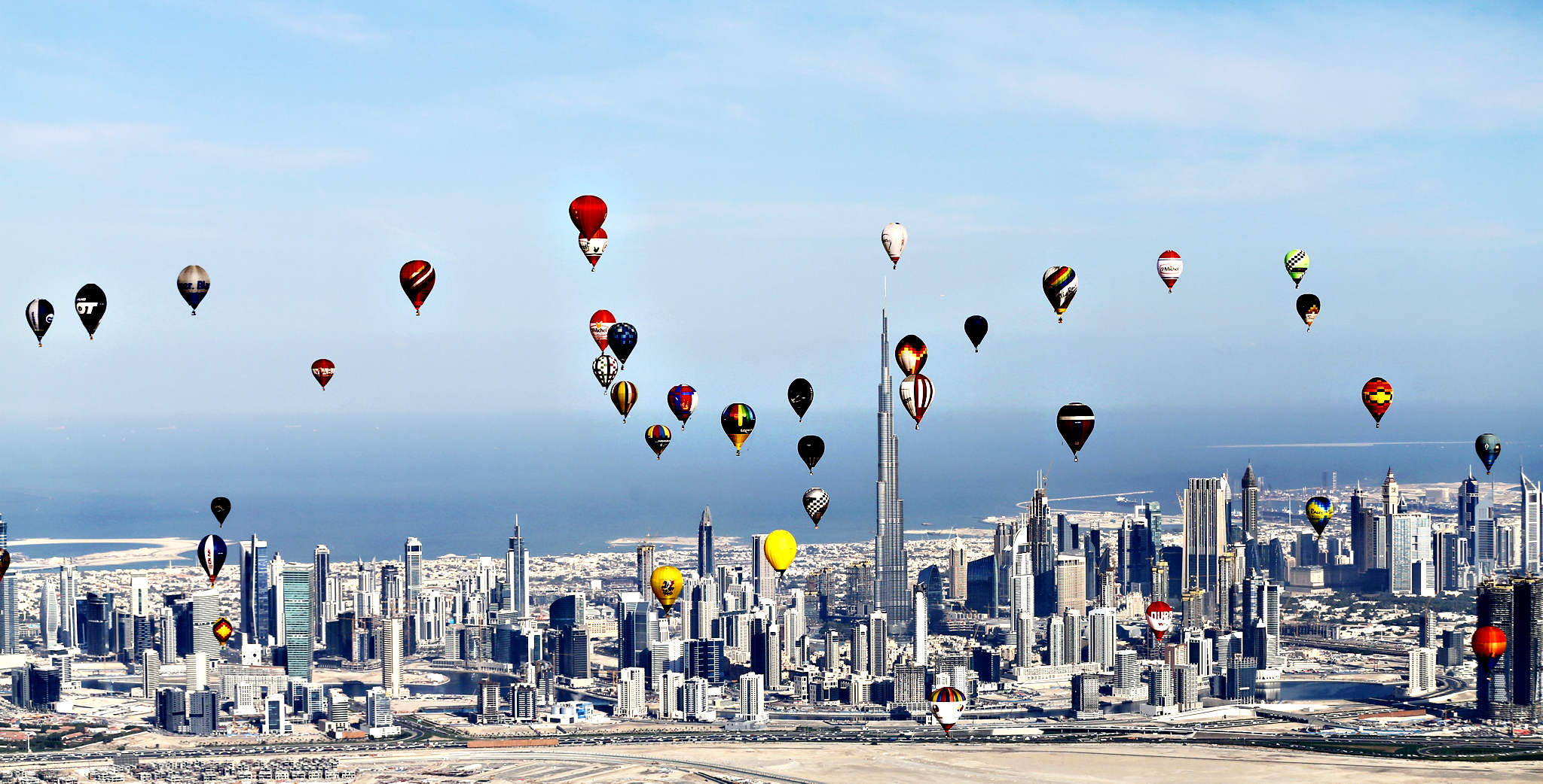 "Hot air balloons fly over Dubai during the World Air Games 2015, held under the rules of the Federation Aeronautique Internationale as part of the ""Dubai International Balloon Fiesta"" event...Hot air balloons fly over Dubai during the World Air Games 2015, held under the rules of the Federation Aeronautique Internationale (FAI) as part of the ""Dubai International Balloon Fiesta"" event, United Arab Emirates December 9, 2015"