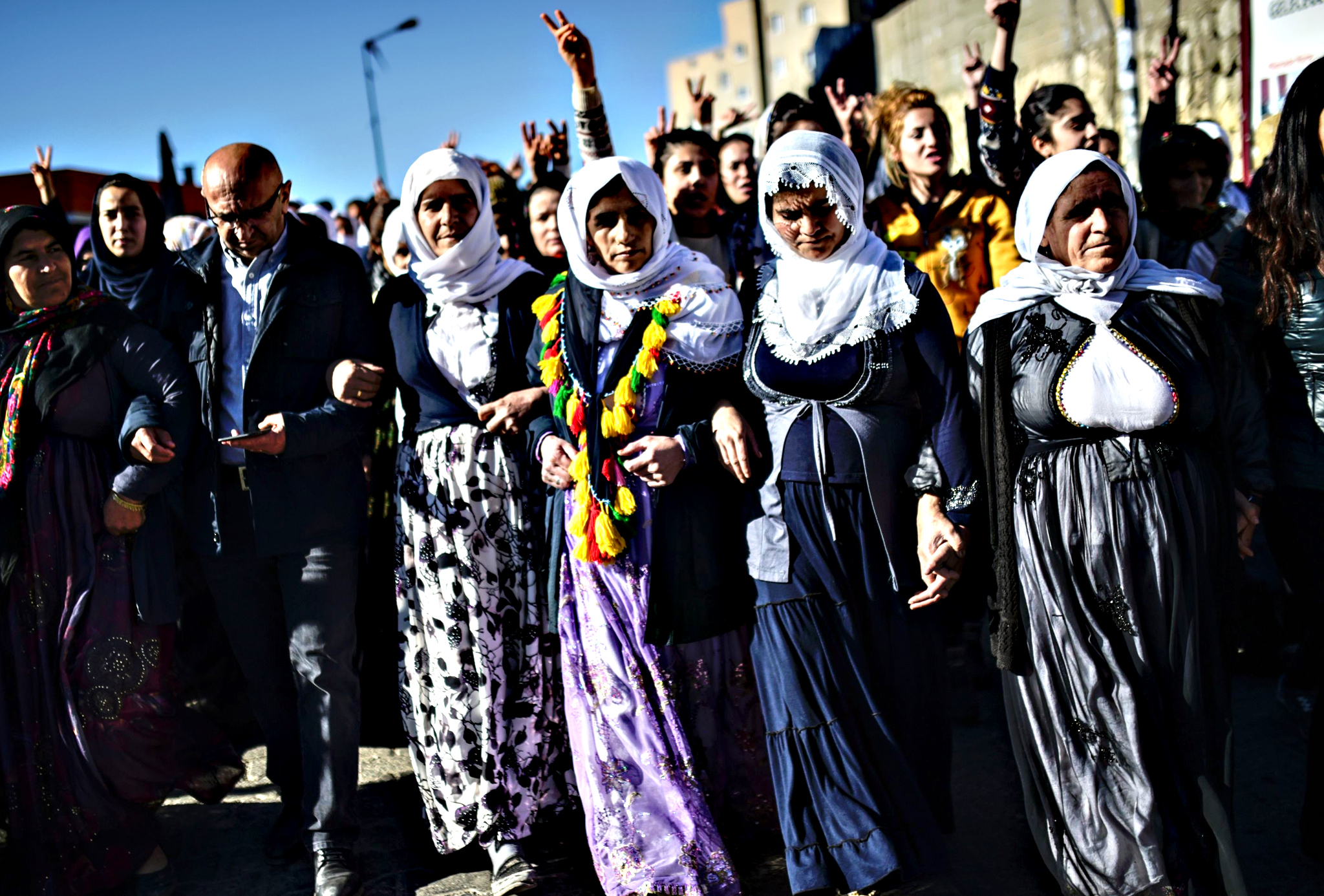 People chant slogans during a protest against security operations against Kurdish rebels in southeastern Turkey cities Cizre and Silopi, in Sirnak on December 22, 2015