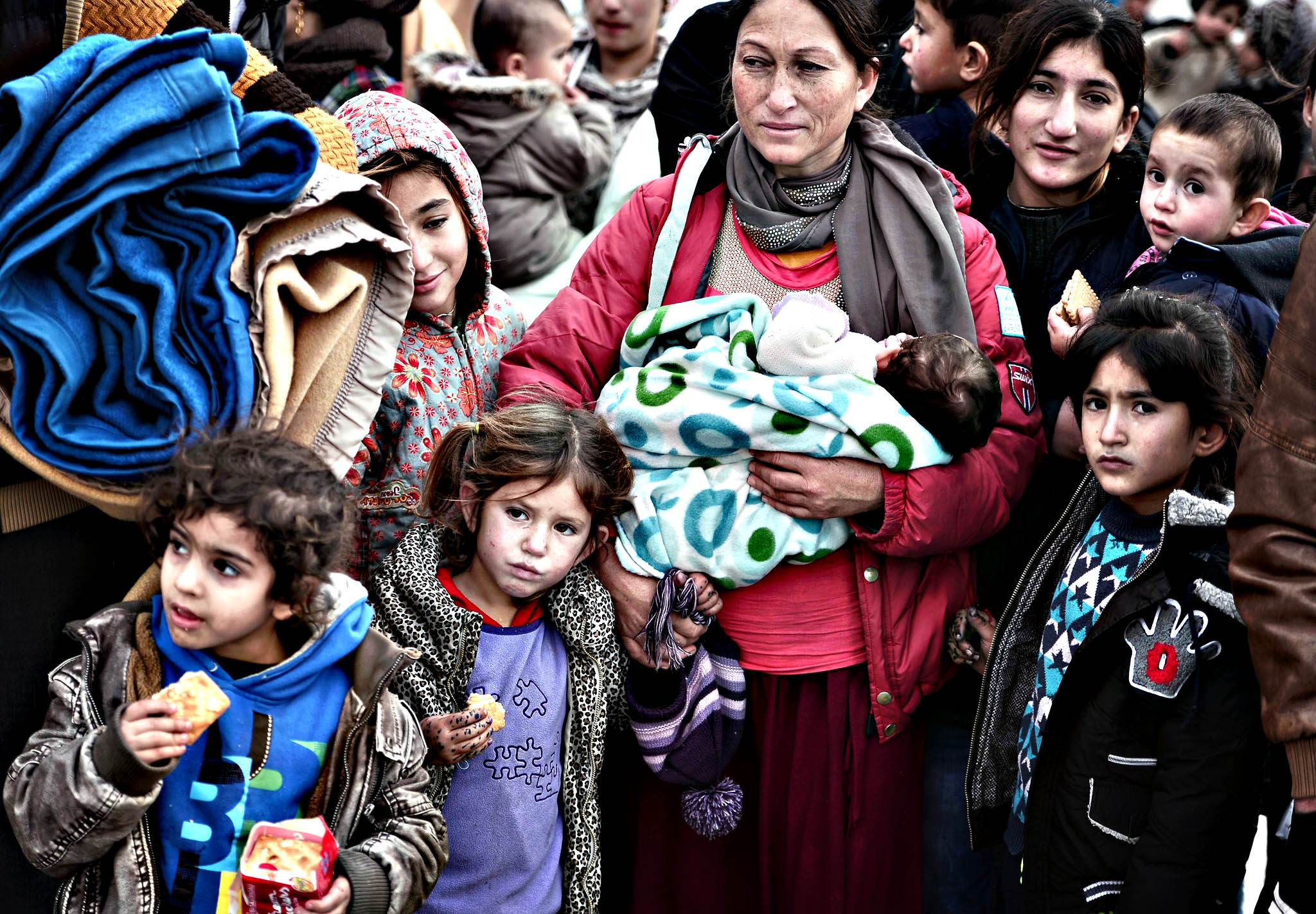 "Refugees and migrants wait for buses lea...Refugees and migrants wait for buses leading them to the city centre, after disembarking from a government chartered ferry in a port of Piraeus near Athens on December 10, 2015.  More than 4000 refugees arrived to the port from the Greek islands of Lesbos and Chios with the majority of them heading by buses to the Greek-Macedonian border.  Greece said on December 10, 2015 it would seek to deport economic migrants, who had been blocked at its border with Macedonia after Skopje clamped down on entry, if they are not entitled to asylum. ""Those without papers, the so-called illegal migrants, have the right to request asylum (or) the right to voluntary repatriation,"" junior interior minister for migration Yiannis Mouzalas told reporters."