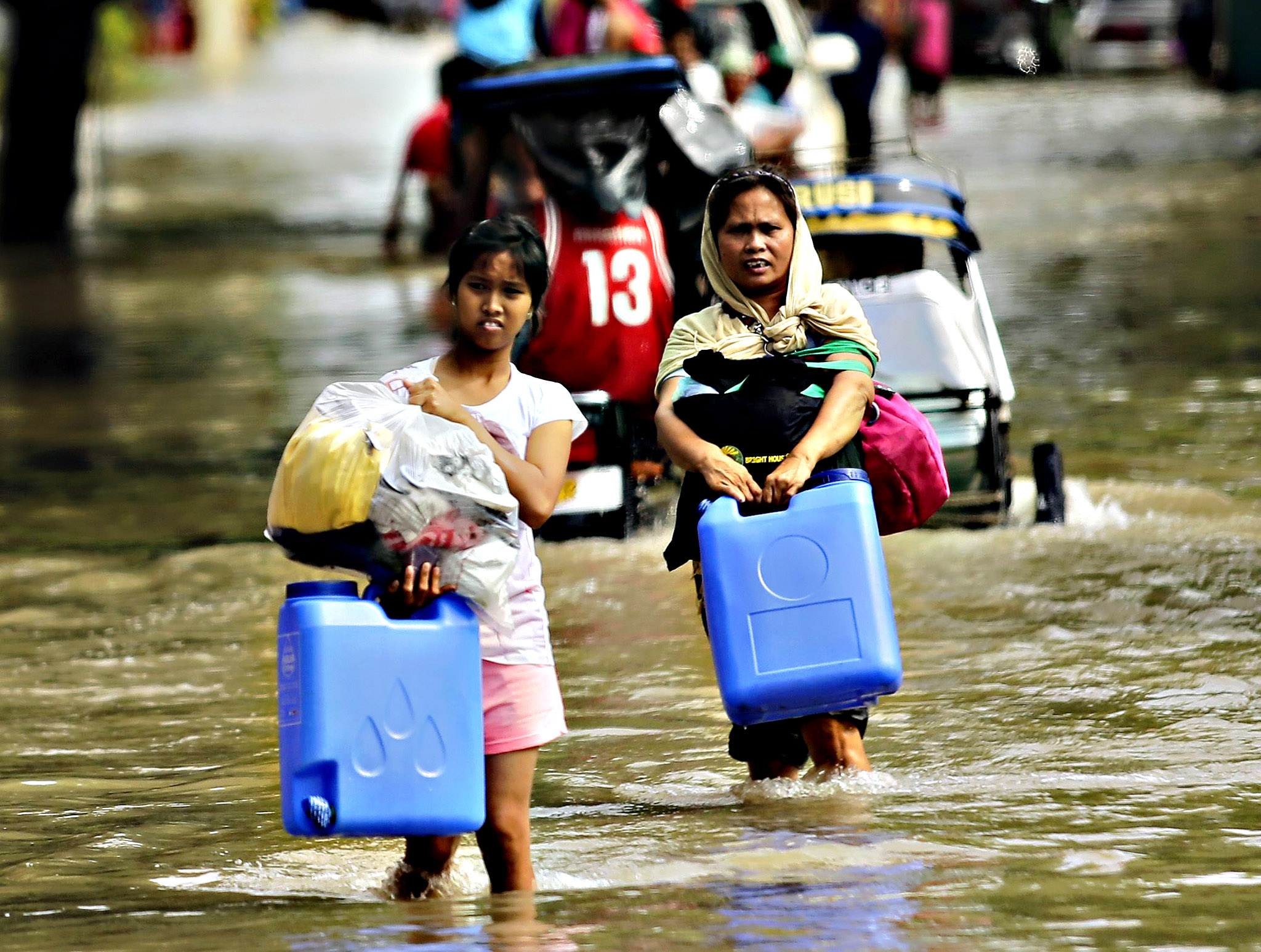Filipino villagers maneuver on floodwater in the typhoon-hit town of La Paz, Tarlac province, southern Manila, Philippines, 17 December 2015. Relief officials on 16 December 2015 rushed aid to tens of thousands of people affected by a typhoon that left at least 12 people dead as a new tropical depression entered Philippine territory. The weather bureau said the tropical depression was spotted Wednesday afternoon 650km off Mati City, in the southern province of Davao Oriental. The arrival of the new tropical depression comes on the heels of Typhoon Melor, which pummeled the Philippines during the past three days. The weather bureau said a weakened Melor, with maximum sustained winds of 100kph near the center and gusts of up to 130kph, continued to move westward at 7kph in the South China Sea.