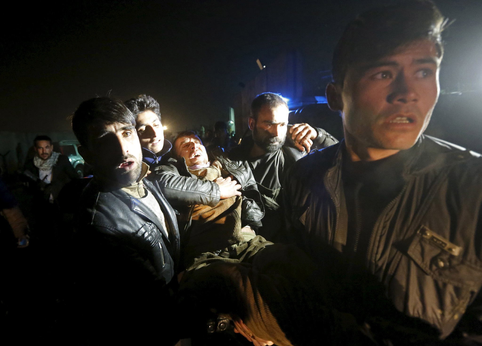 "Afghan men carry a wounded man at the site of an explosion in Kabul, Afghanistan January 4, 2016. A large explosion struck close to Kabul airport on Monday, causing at least 10 casualties near to the area where a suicide bomber blew himself up earlier in the day in the latest in a series of attacks in the Afghan capital over the past week. REUTERS/Omar Sobhani       TPX IMAGES OF THE DAYREUTERS NEWS PICTURES HAS NOW MADE IT EASIER TO FIND THE BEST PHOTOS FROM THE MOST IMPORTANT STORIES AND TOP STANDALONES EACH DAY. Search for ""TPX"" in the IPTC Supplemental Category field or ""IMAGES OF THE DAY"" in the Caption field and you will find a selection of 80-100 of our daily Top Pictures."