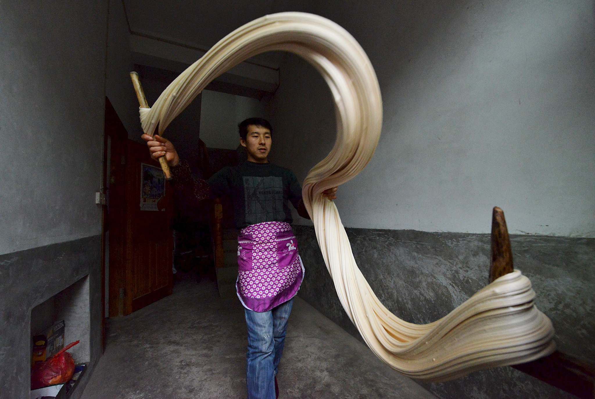"A man makes traditional candy ""Matang"" in preparation for the upcoming Chinese Lunar New Year in Yuqing County...A man makes traditional candy ""Matang"" in preparation for the upcoming Chinese Lunar New Year in Yuqing County, Zunyi, Guizhou Province, China, January 18, 2016. REUTERS/China Daily ATTENTION EDITORS - THIS PICTURE WAS PROVIDED BY A THIRD PARTY. THIS PICTURE IS DISTRIBUTED EXACTLY AS RECEIVED BY REUTERS, AS A SERVICE TO CLIENTS. CHINA OUT. NO COMMERCIAL OR EDITORIAL SALES IN CHINA."