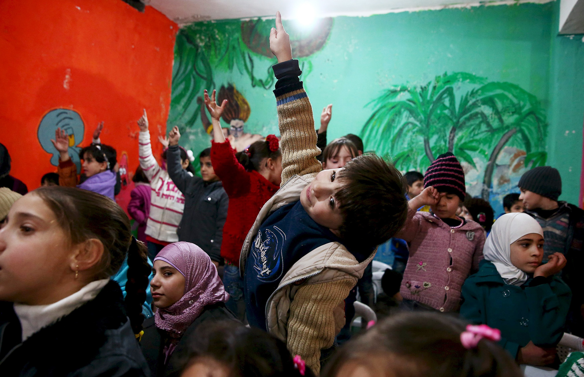 Children attend a party for children affected by war and in need for psychological support, in the Douma neighborhood of Damascus...Children attend a party for children affected by war and in need for psychological support, in the Douma neighborhood of Damascus, Syria January 24, 2016. The party was organized by the Syrian Arab Red Crescent. Picture taken January 24, 2016. REUTERS/Bassam Khabieh