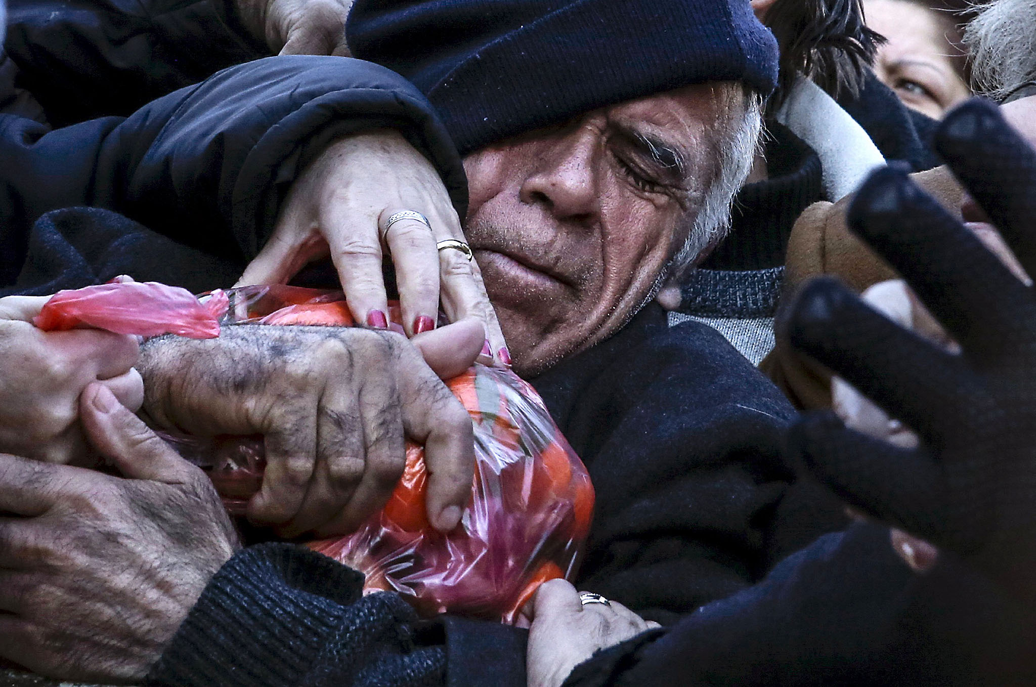 "ATTENTION EDITORS - REUTERS PICTURE HIGHLIGHT...ATTENTION EDITORS - REUTERS PICTURE HIGHLIGHTKON107A man grasps a bag of tangerines as people receive free produce, handed out by farmers, during a protest over the government's proposal to overhaul the country's ailing pension system in Athens, Greece, January 27, 2016. REUTERS/Alkis Konstantinidis      TPX IMAGES OF THE DAYREUTERS NEWS PICTURES HAS NOW MADE IT EASIER TO FIND THE BEST PHOTOS FROM THE MOST IMPORTANT STORIES AND TOP STANDALONES EACH DAY. Search for ""TPX"" in the IPTC Supplemental Category field or ""IMAGES OF THE DAY"" in the Caption field and you will find a selection of 80-100 of our daily Top Pictures.REUTERS NEWS PICTURES. TEMPLATE OUT"