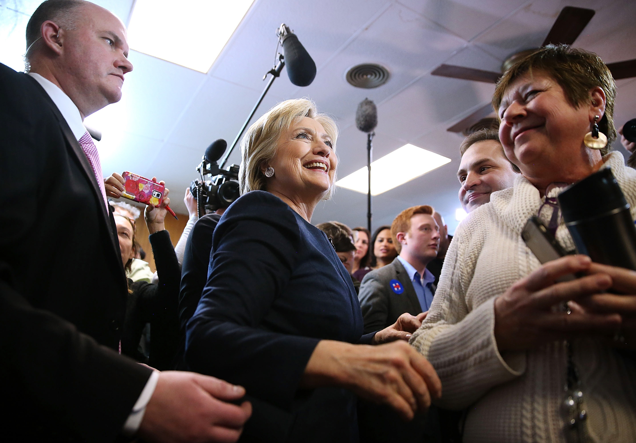 "Hillary Clinton Holds Get Out The Caucus Event In Iowa...ADEL, IA - JANUARY 27:  Democratic presidential candidate former Secretary of State Hillary Clinton greets supporters during a ""get out the caucus"" event at the Adel Family Fun Center on January 27, 2016 in Adel, Iowa.  With less than a week to go before the Iowa caucuses, Hillary Clinton is campaigning throughout Iowa.  (Photo by Justin Sullivan/Getty Images)"