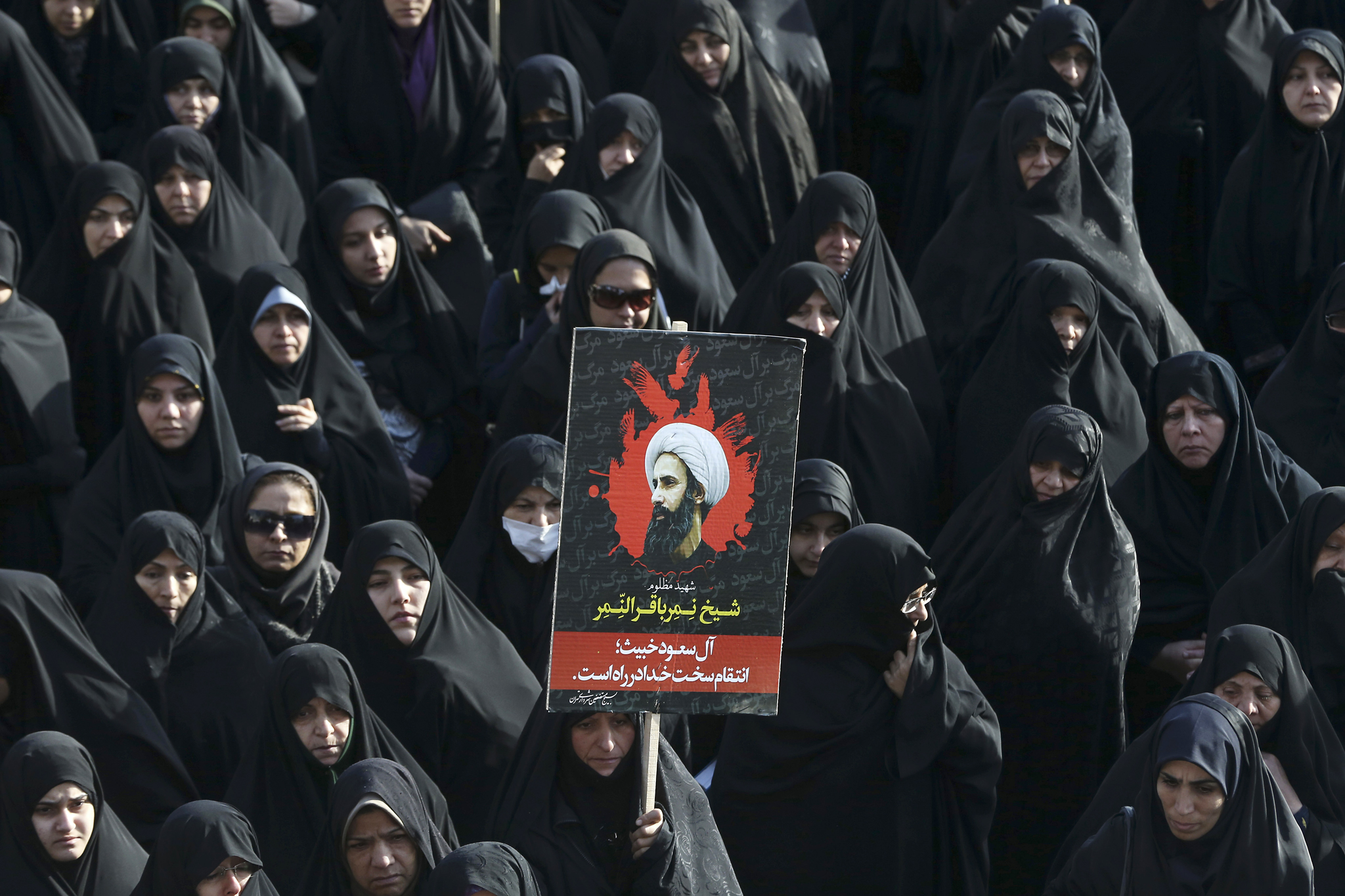 Nimr al-Nimr...An Iranian woman holds up a poster showing Sheikh Nimr al-Nimr, a prominent opposition Saudi Shiite cleric who was executed last week by Saudi Arabia, in Tehran, Iran, Monday, Jan. 4, 2016. Allies of Saudi Arabia followed the kingdom's lead and began scaling back diplomatic ties to Iran on Monday after the ransacking of Saudi diplomatic missions in the Islamic Republic, violence sparked by the Saudi execution of al-Nimr. (AP Photo/Vahid Salemi)