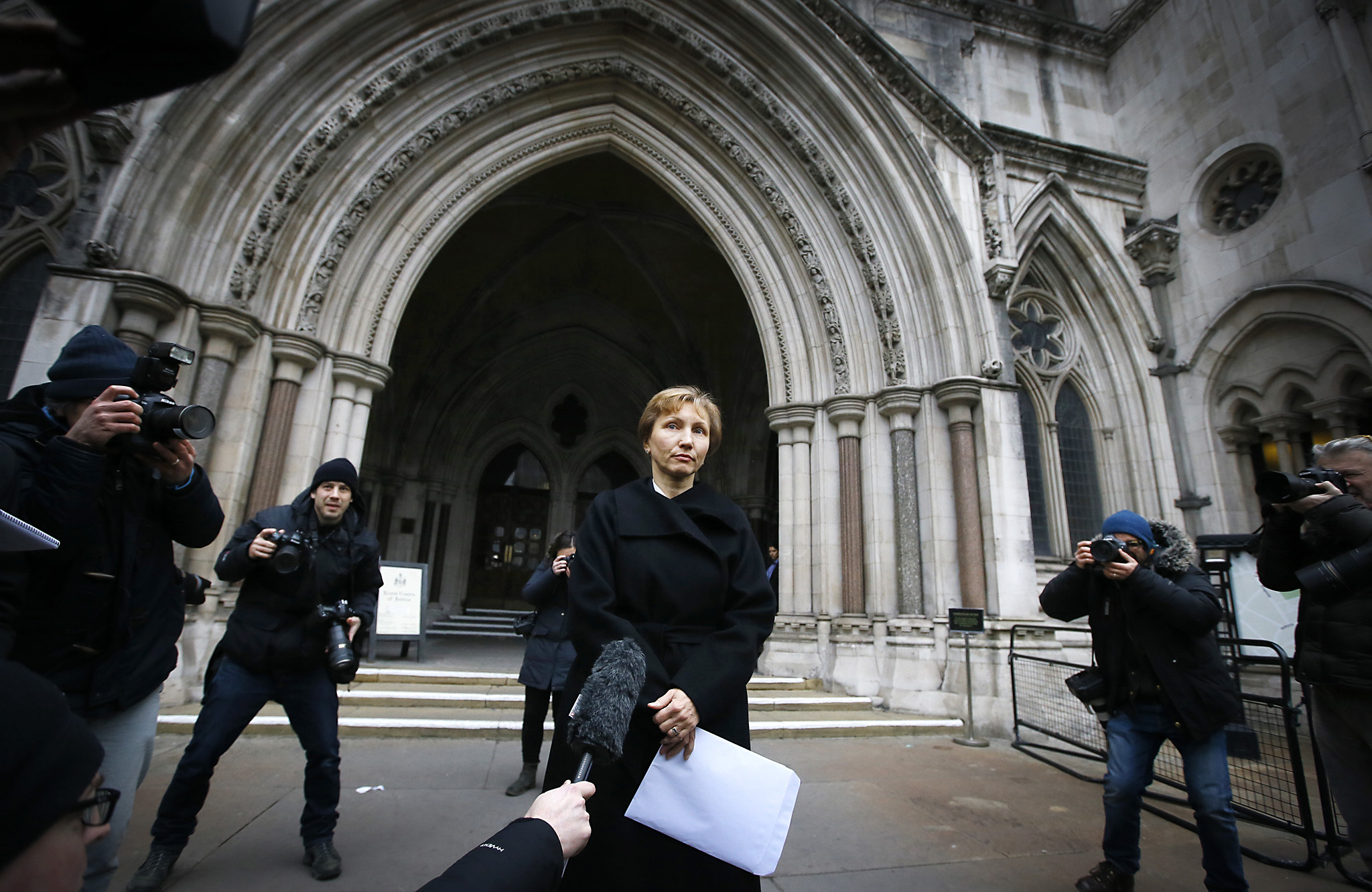 Marina Litvinenko, widow of former Russian spy Alexander Litvinenko, reads a statement outside the Royal Courts of Justice in London, Thursday, Jan. 21, 2016. British judge Robert Owen is set to release Thursday the findings of a lengthy public inquiry into the 2006 poisoning death of former Russian spy Alexander Litvinenko. One day in 2006, Litvinenko a former KGB agent who claimed to know dark Kremlin secrets had tea with two Russian men at the hotel. Three weeks later, he died of radioactive poisoning ó after making a deathbed claim that Russian President Vladimir Putin had ordered his killing. (AP Photo/Kirsty Wigglesworth)
