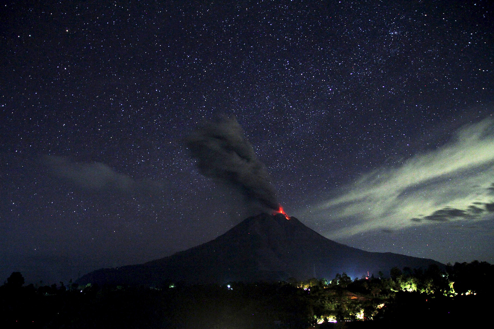 Indonesia's Mount Sinabung volcano spews lava and ash
