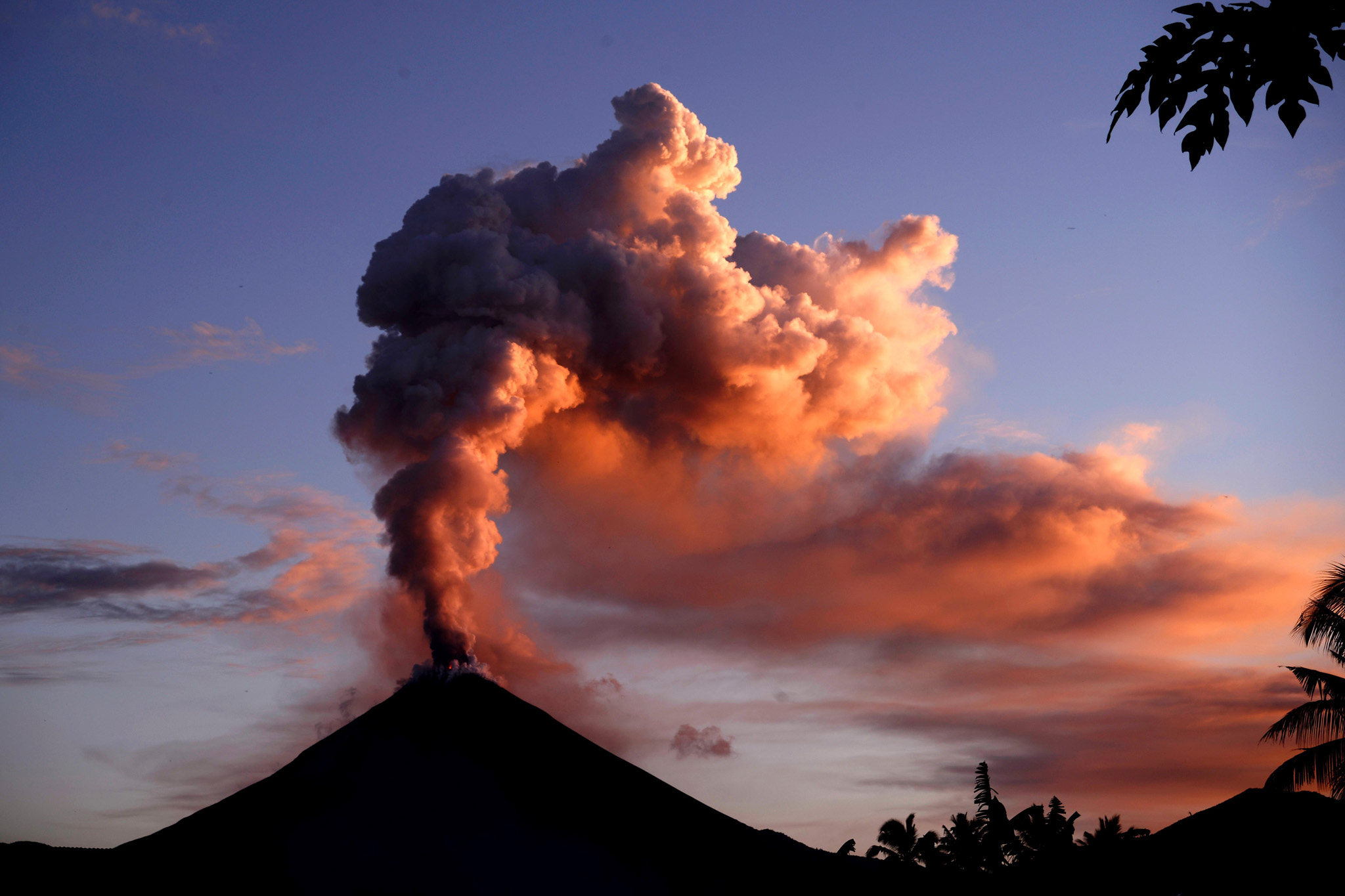 Mount Soputan spews ash into t...TOPSHOT - Mount Soputan spews ash into the air during an eruption seen from Silian village, Southeast Minahasa district in Northern Sulawesi  on January 5, 2016. Mount Soputan is one of the most active volcanoes in North Sulawesi and last erupted in March 2015.  AFP PHOTO / Adi DWI SATRYA / AFP / ADI DWI SATRYAADI DWI SATRYA/AFP/Getty Images