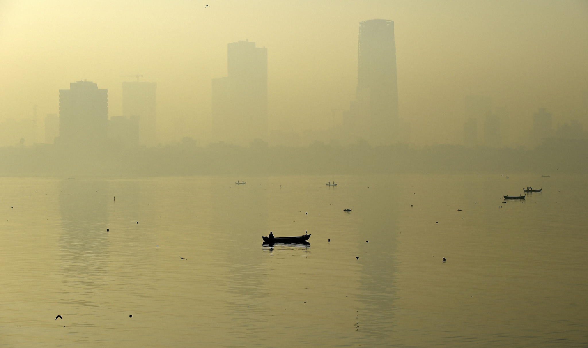 TOPSHOT - A fishing boat is seen in the ...TOPSHOT - A fishing boat is seen in the morning general view of the city skyline covered by a smoggy haze in Mumbai on January 29, 2016.  AFP PHOTO / PUNIT PARANJPE / AFP / PUNIT PARANJPEPUNIT PARANJPE/AFP/Getty Images