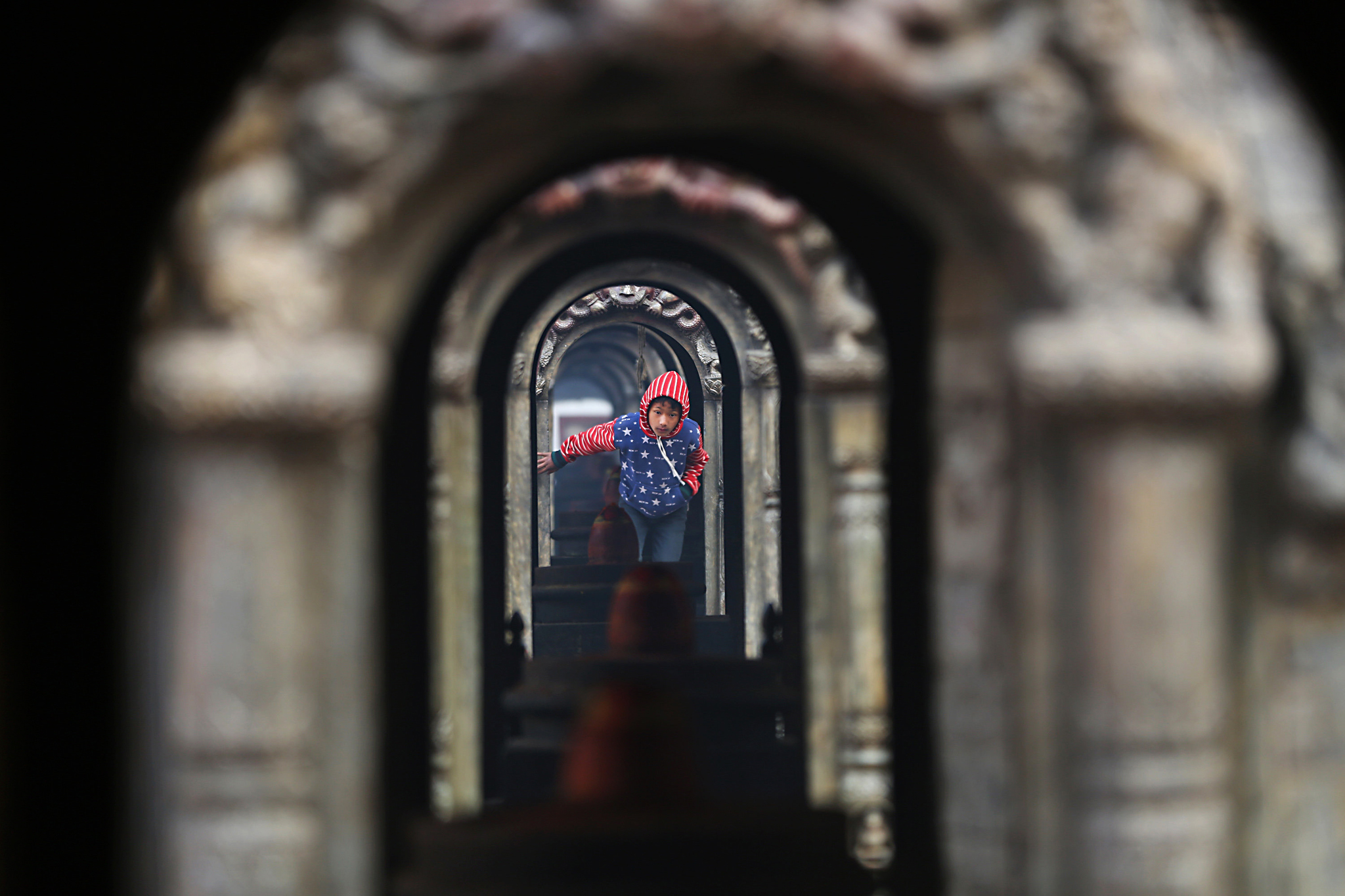 A Nepalese boy walks out of Pashupatinath hindu temple after offering morning prayers in Kathmandu, Nepal, Monday, Jan. 18, 2016. (AP Photo/Niranjan Shrestha)