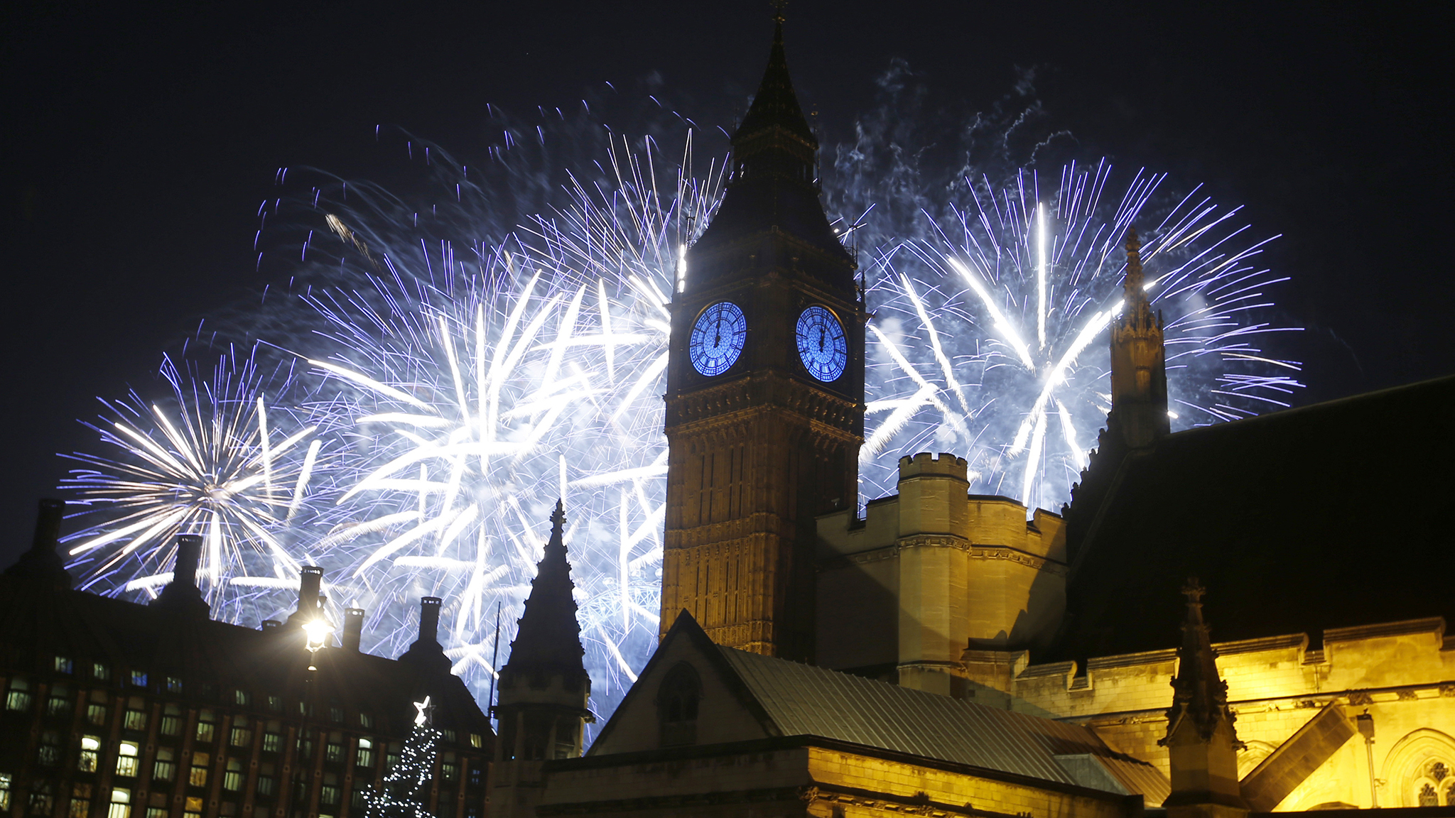 Fireworks explode over the River Thames and the Palace of Westminster as the New Year's Day celebrations begin in London.